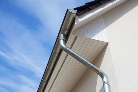 Gutter and downspout on roof.