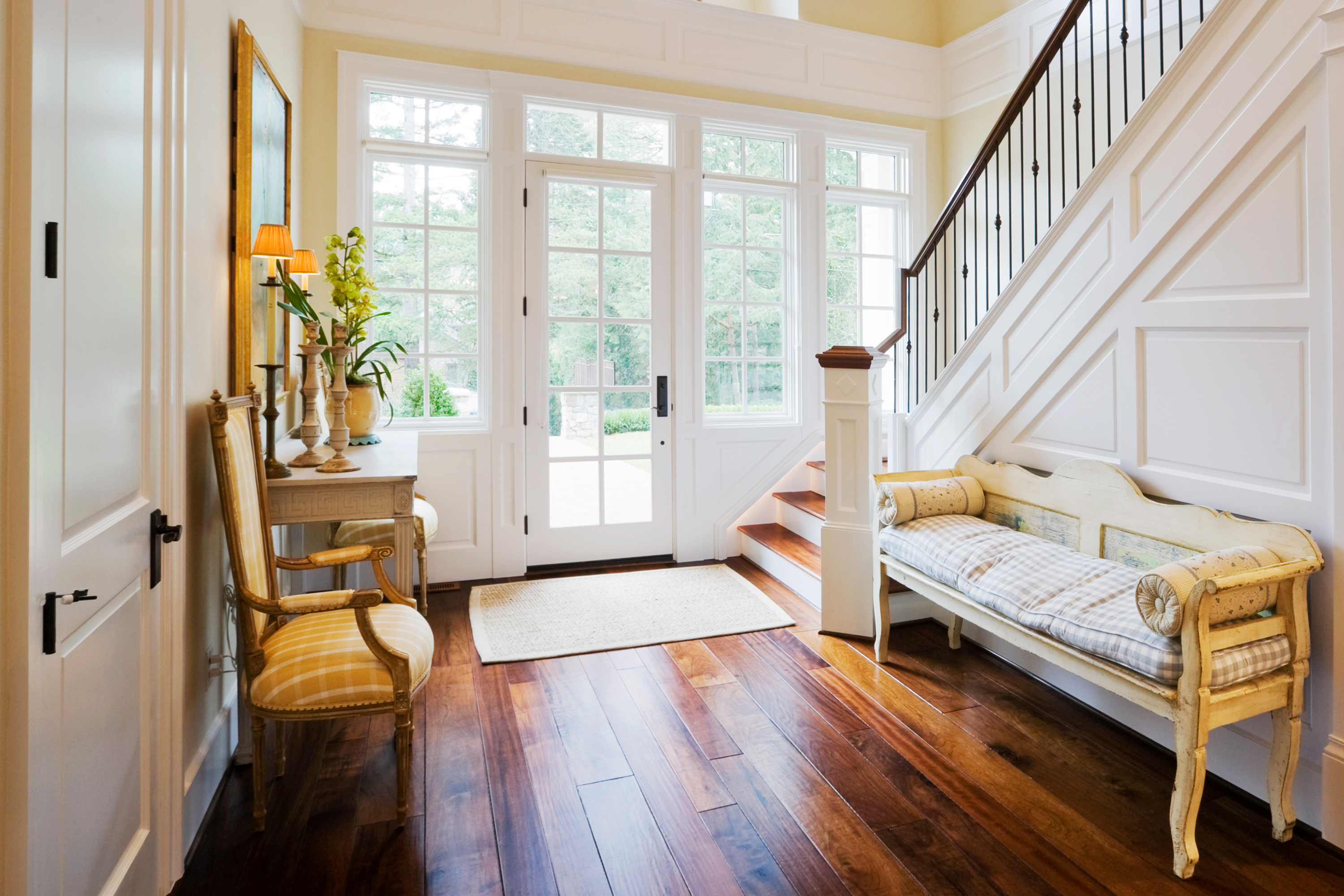 Foyer with wood flooring and staircase.