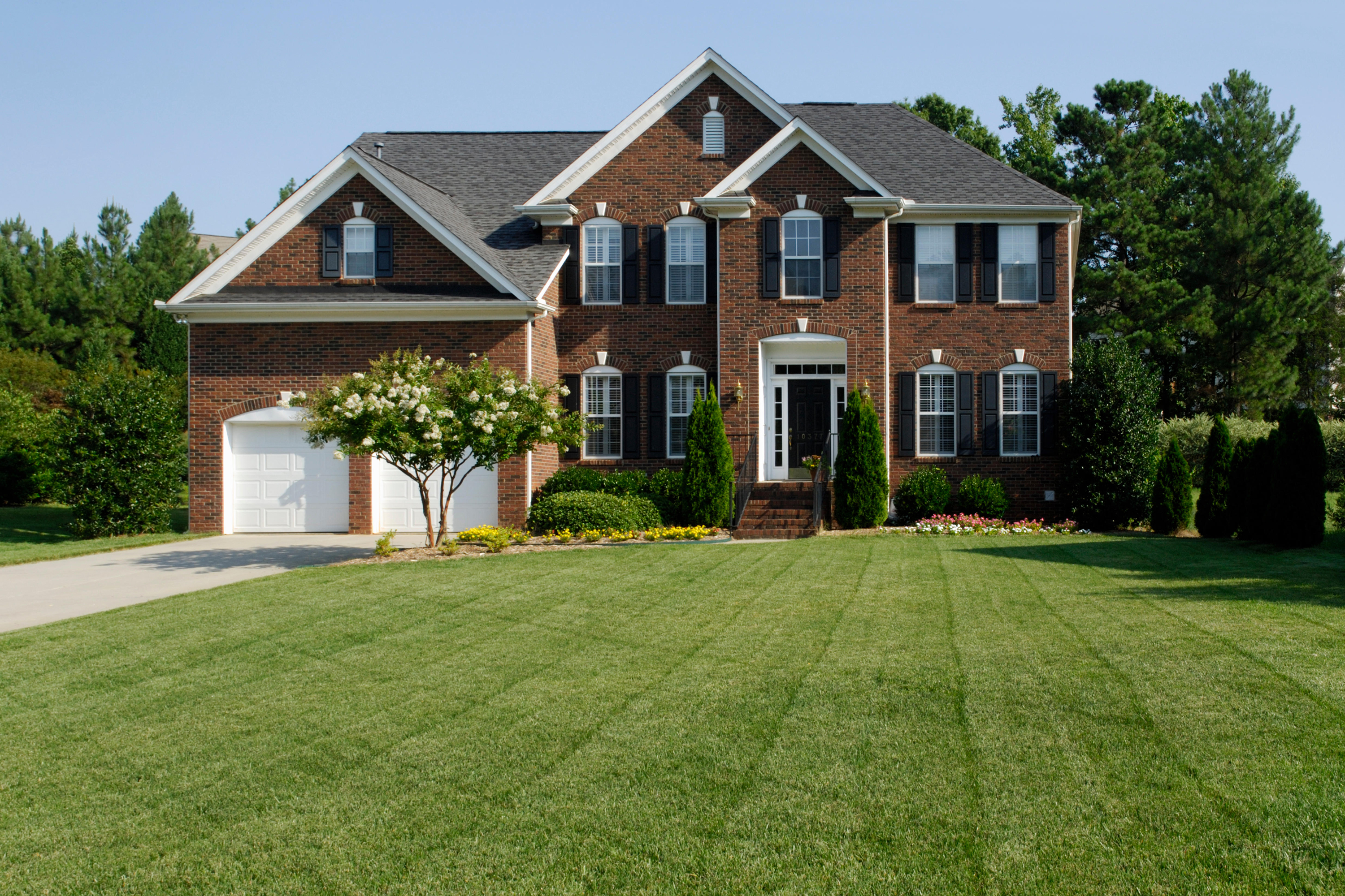 American home with a lush lawn.