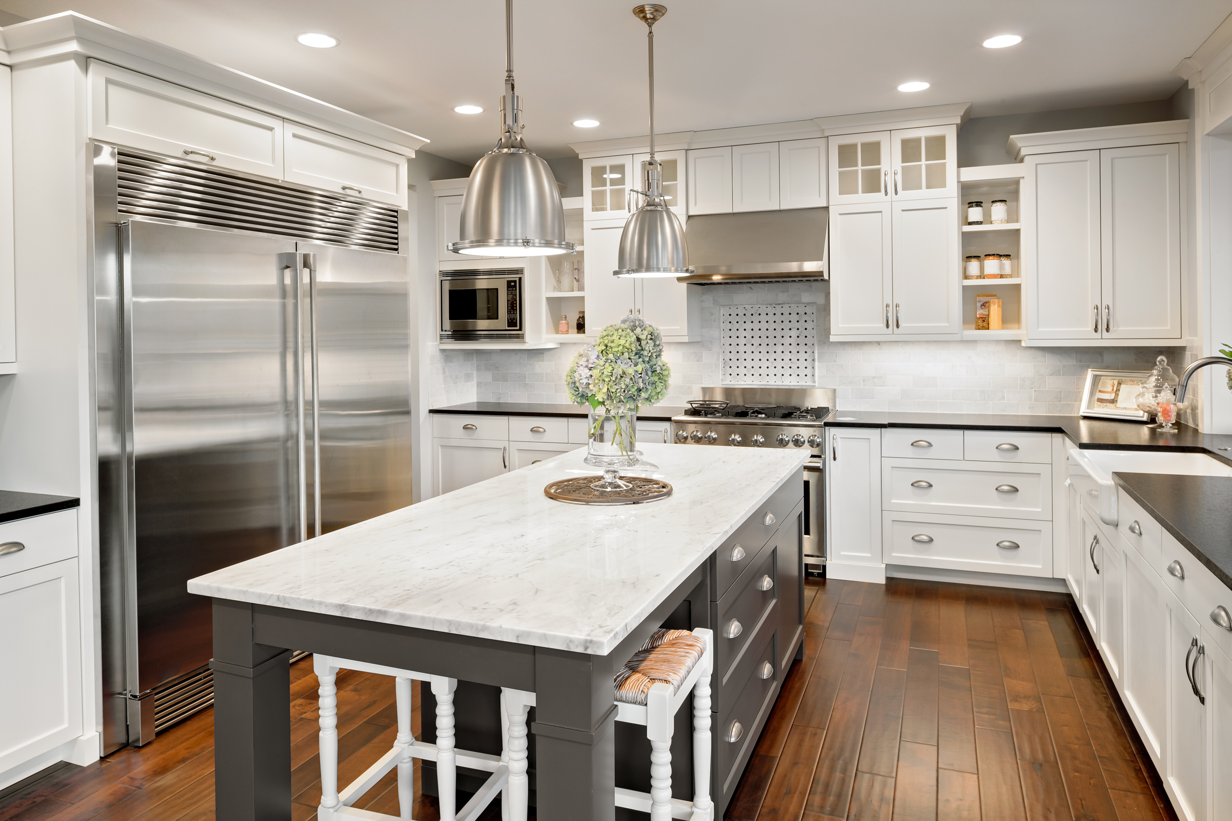 Remodeled kitchen with white cabinets and modern appliances.
