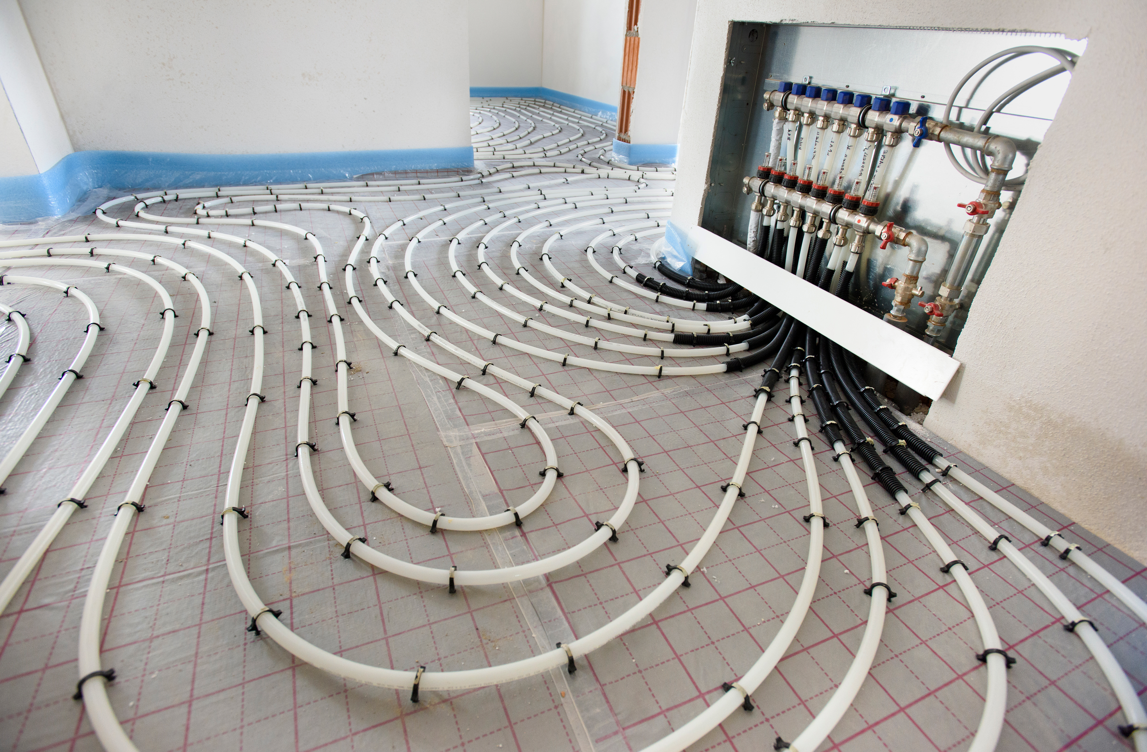 Pipes of under floor heating in construction of new residential house.