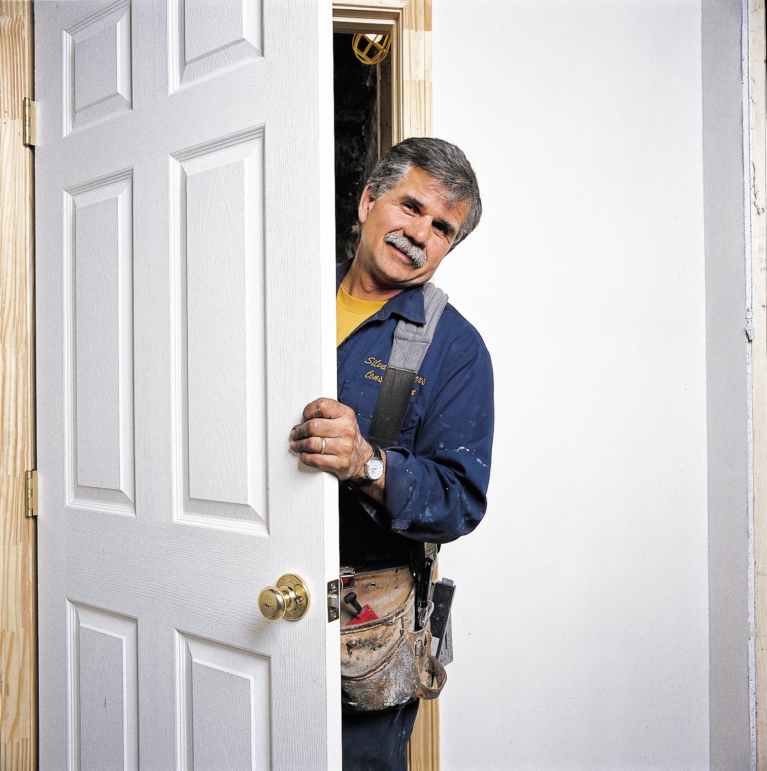Man Holding Prehung Door