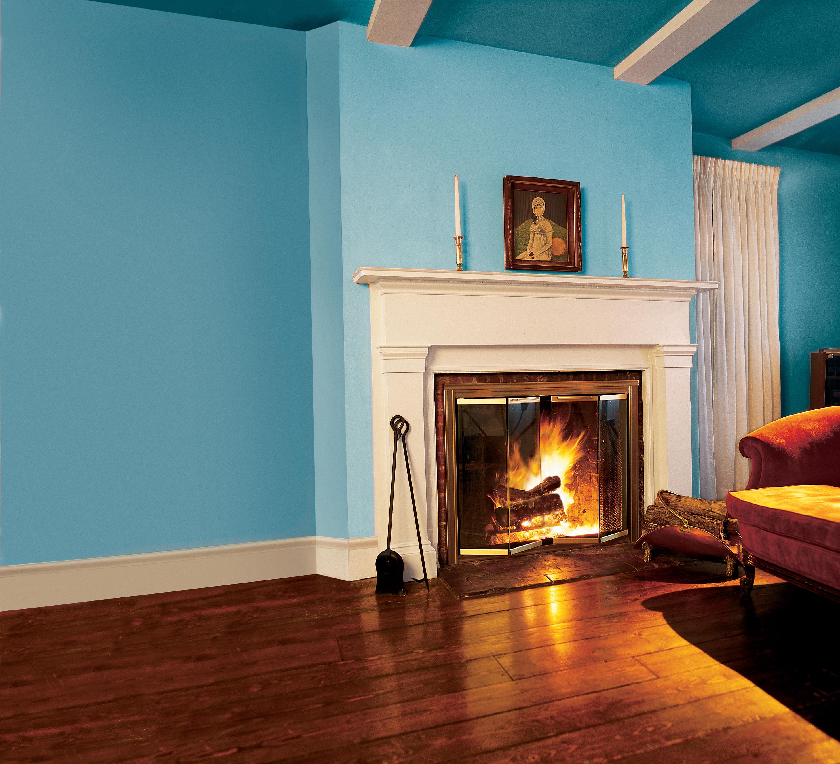 Glass fireplace doors retrofitted onto a fireplace.