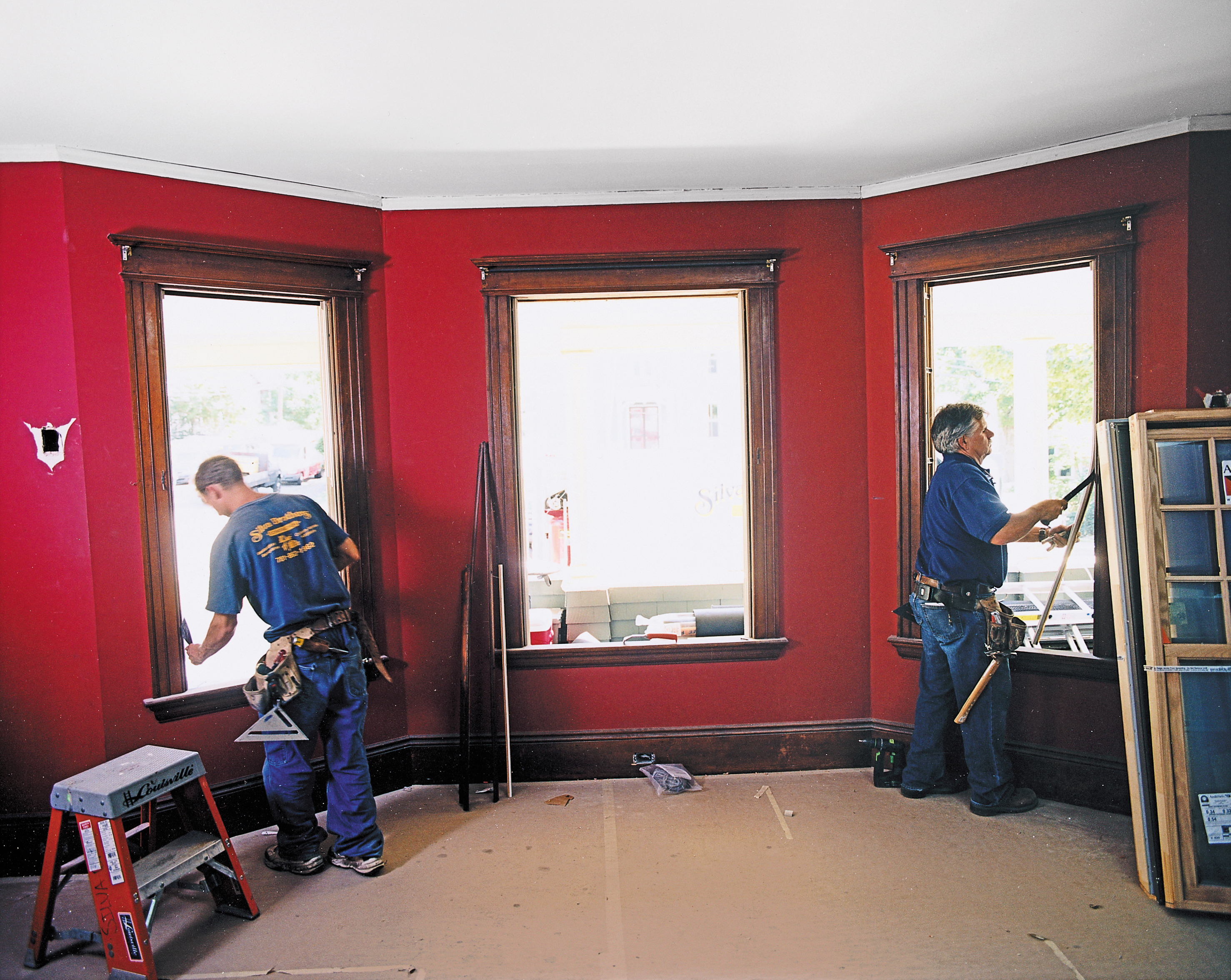 Men Installing New Windows To Replace Old Windows