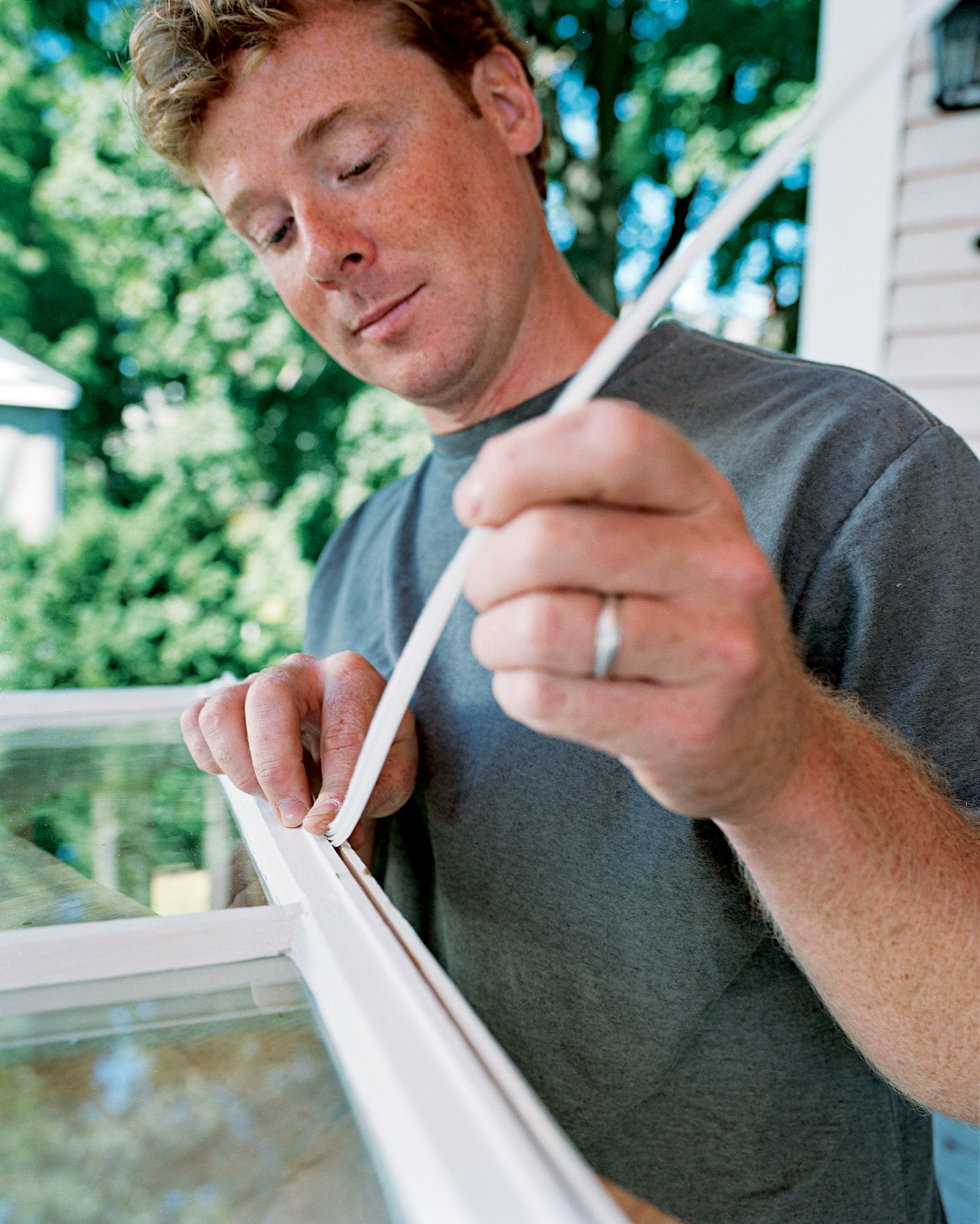 Person weatherstripping double hung window.