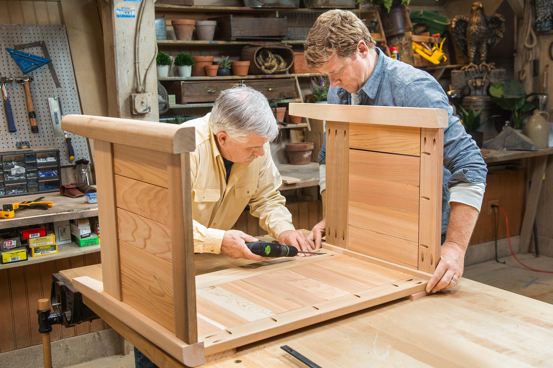 Tom and Kevin building a cedar planter.