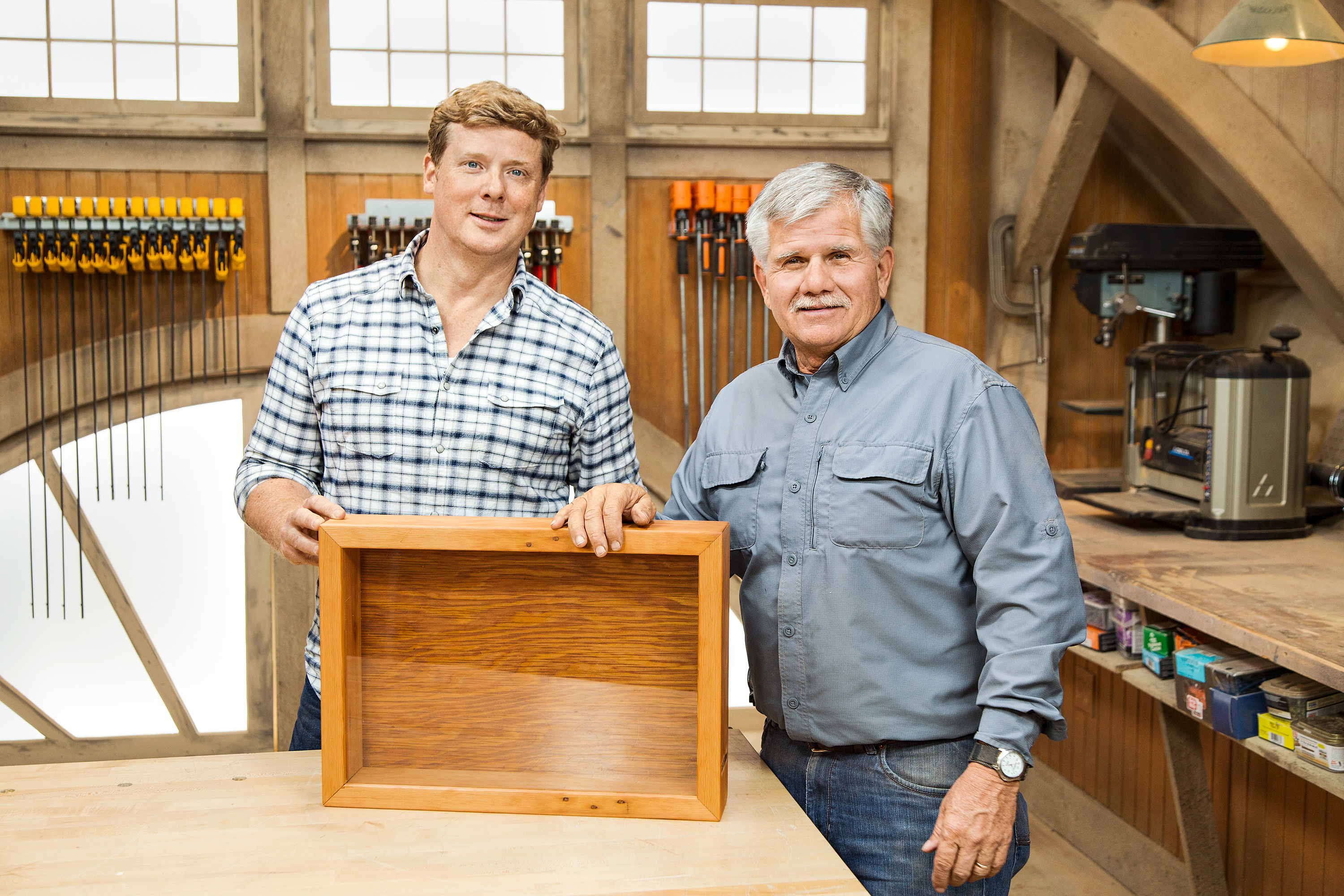 TOH general contractor Tom Silva and TOH host Kevin O'Connor proudly present their latest project, a glass-fronted shadow box. Filled with valued objects, such as those below, it keeps the keepsakes safe and makes them easy to admire.
