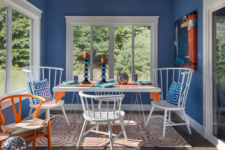 Blue and orange sunroom.