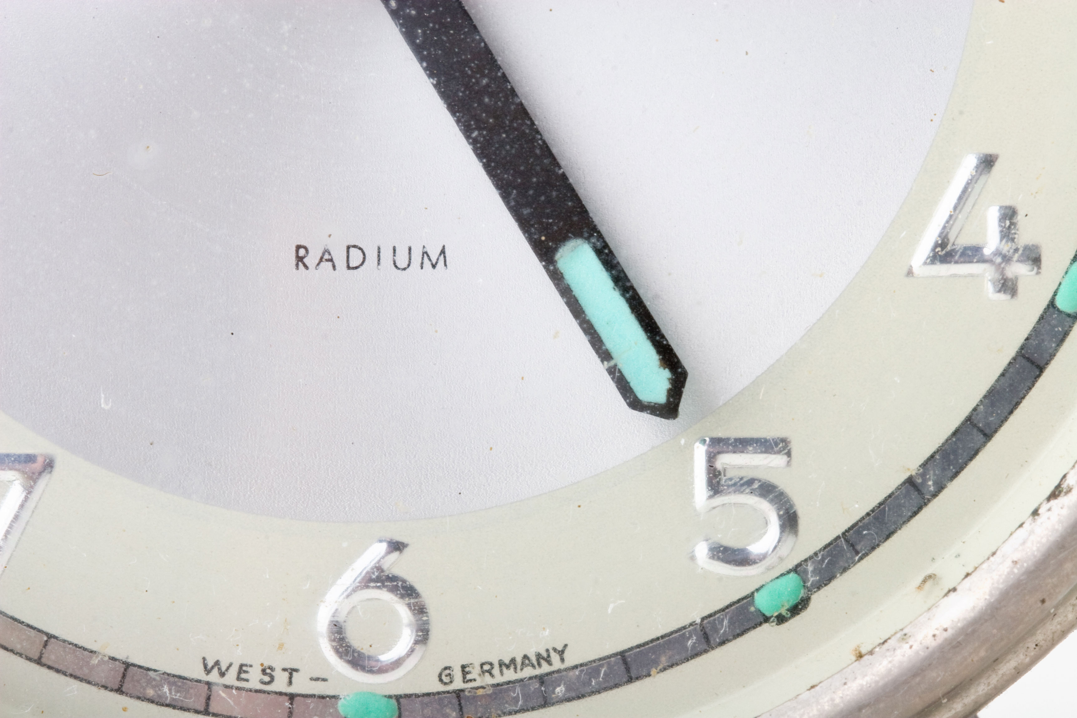An old watch face with glow in the dark radium dials.