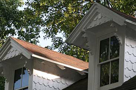 Two dormers on a roof.