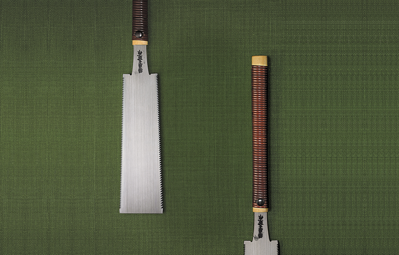 Two Japanese saws laying next to each other.