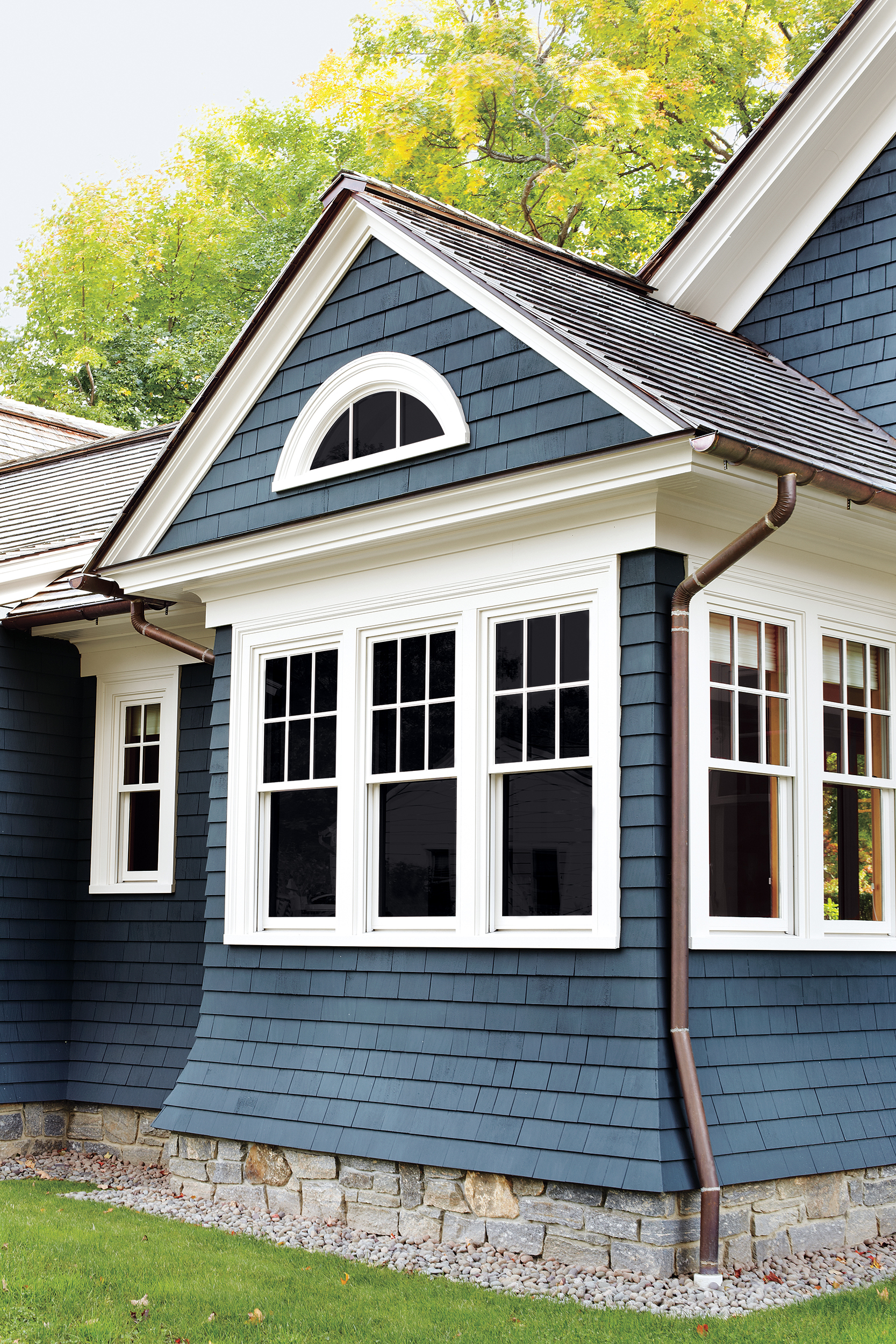 Copper Half-Round Gutters And Round Downspouts On Traditional House Designs