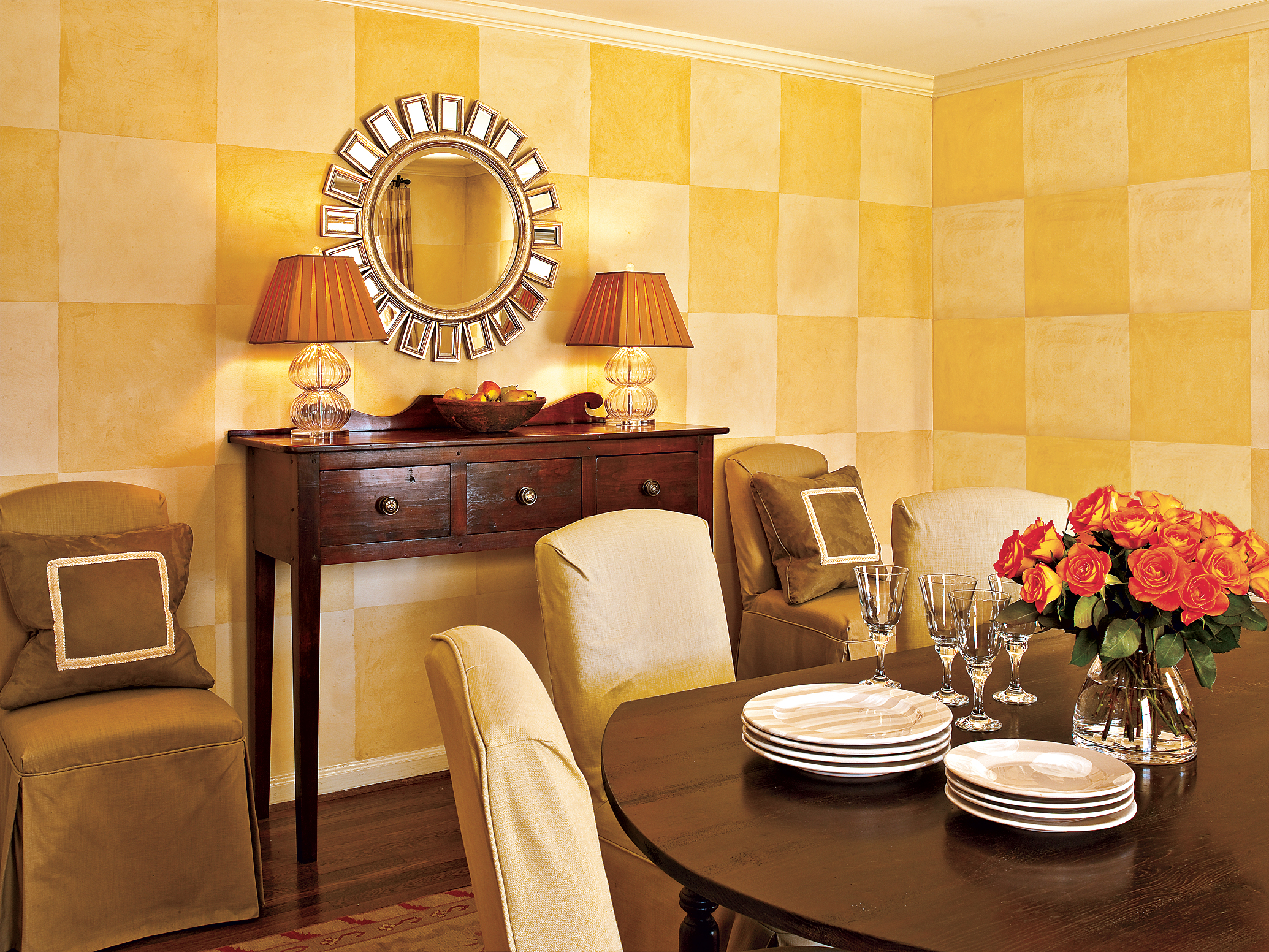 Checkered yellow wall painting in a dining room.