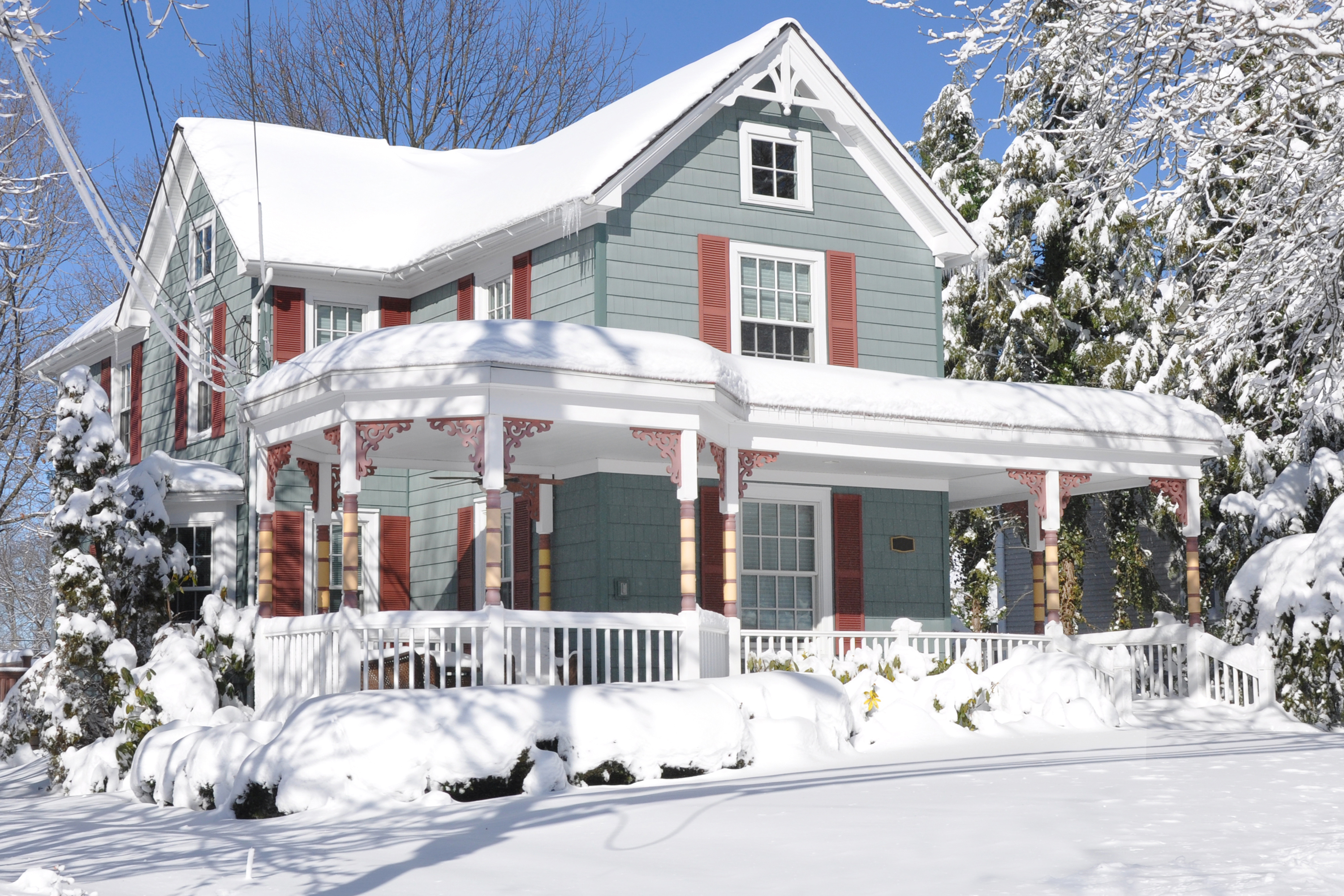 Snow covered suburban home.