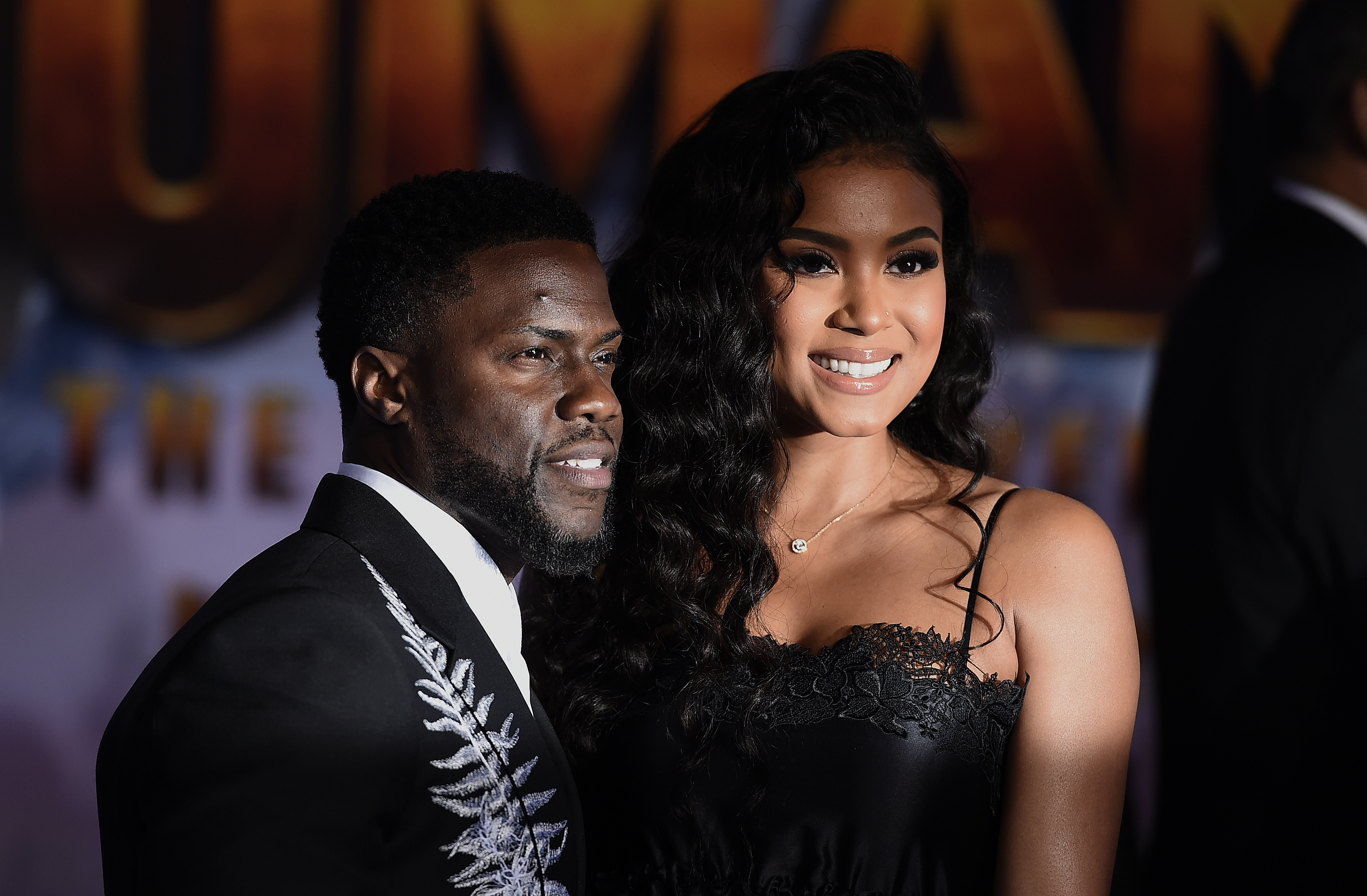 "Cast member Kevin Hart, left, and his wife, Eniko Parrish, arrive at the Los Angeles premiere of ""Jumanji: The Next Level"" at the TCL Chinese Theatre on Monday, Dec. 9, 2019."
