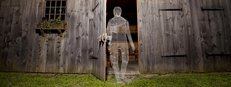 Chicken wire ghost placed in barn doorway.