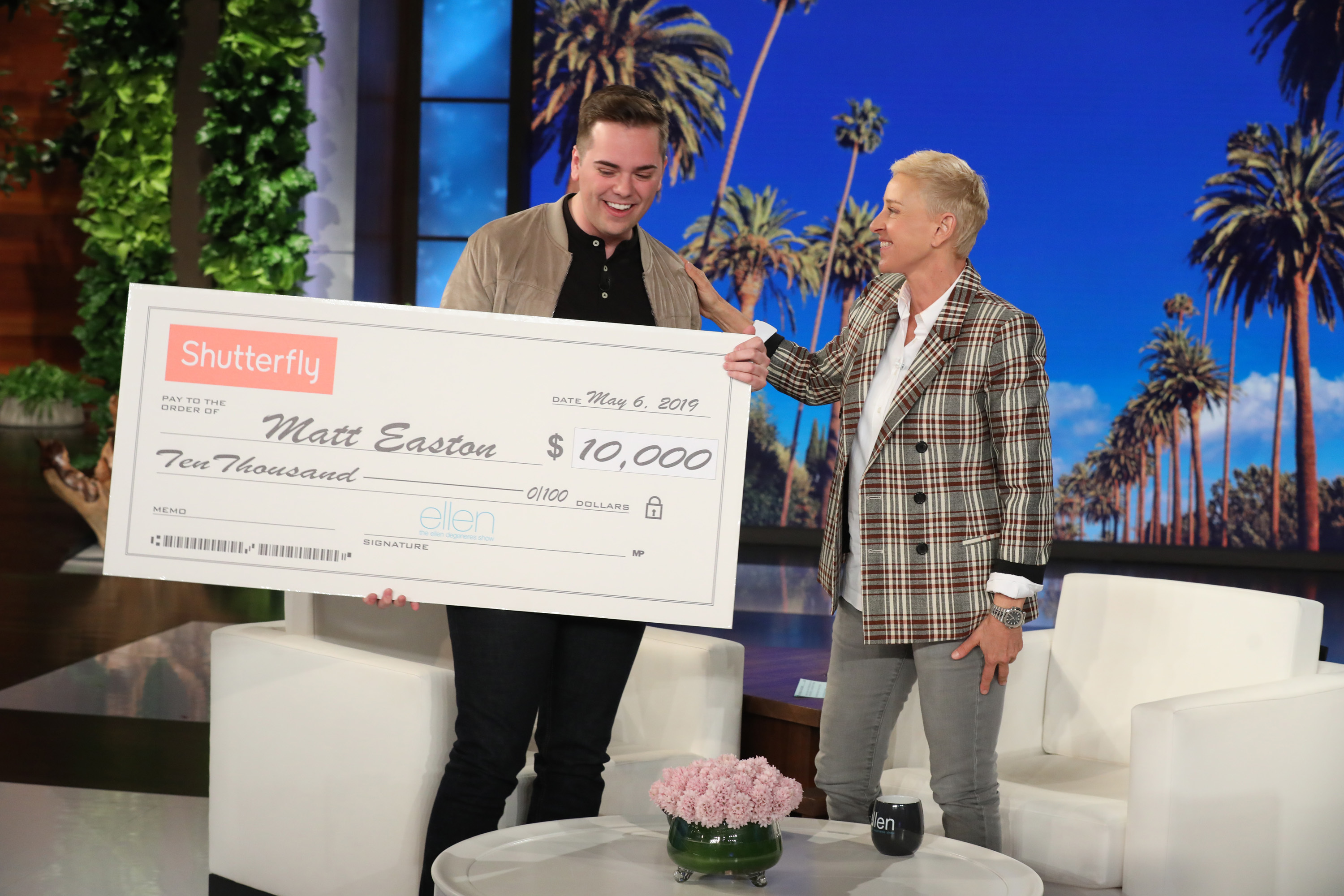 "BYU graduate Matt Easton accepts a $10,000 gift from talk show host Ellen DeGeneres during a taping of ""The Ellen DeGeneres Show"" at the Warner Bros.' lot in Burbank, Calif."