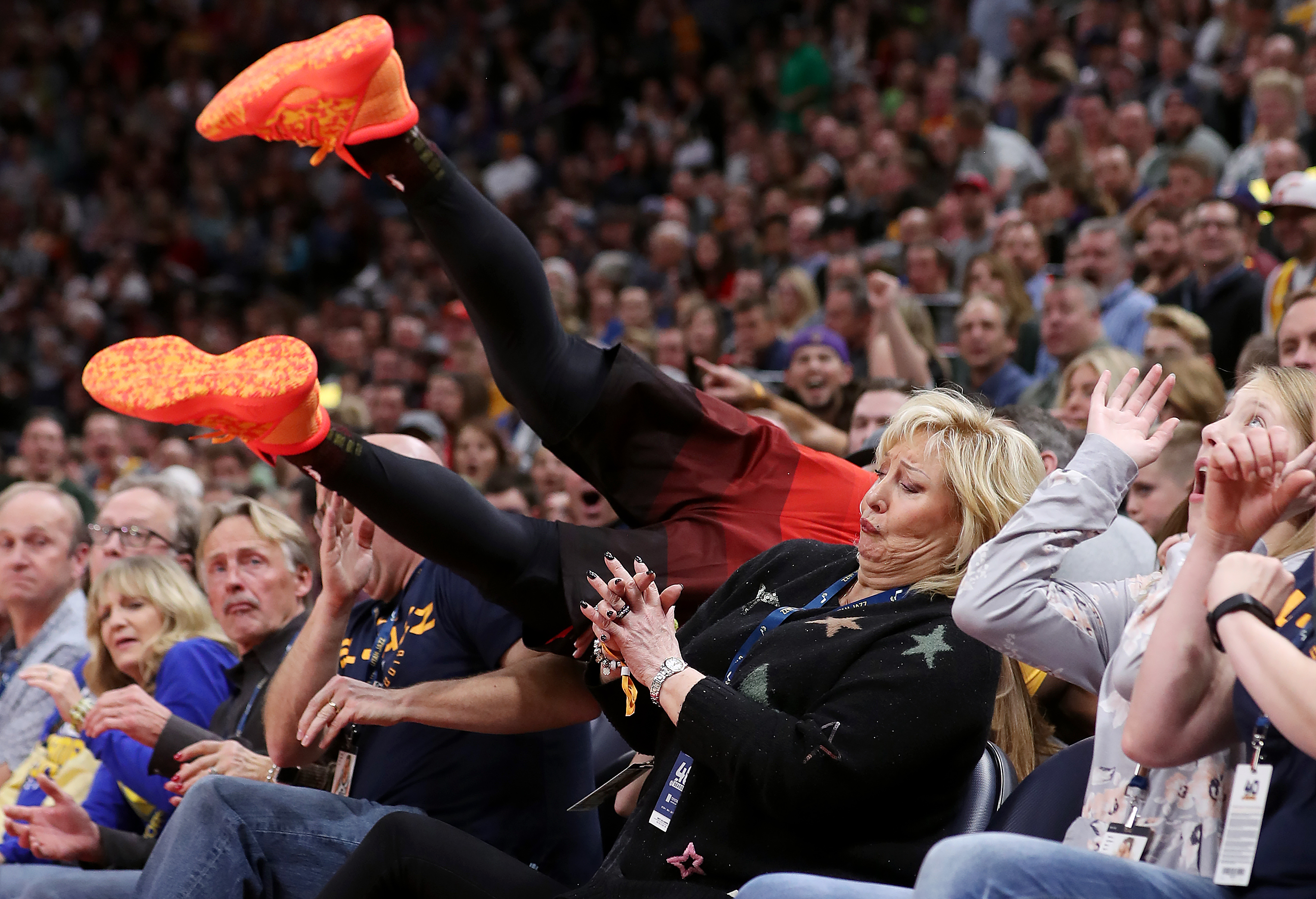 Utah Jazz guard Donovan Mitchell (45) crashes into the front two rows as the Utah Jazz and the Golden State Warriors play an NBA basketball game at Vivint Smart Home Arena in Salt Lake City on Wednesday, Dec. 19, 2018. Jazz won 108-103.