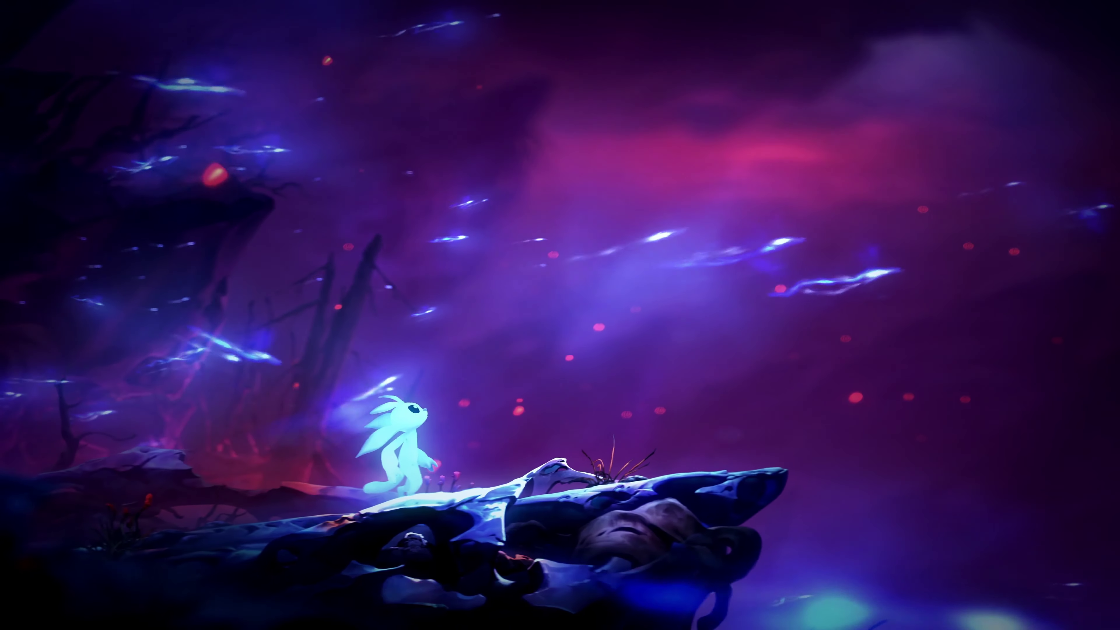 a white figure on a rock ledge in Ori and the Will of the Wisps