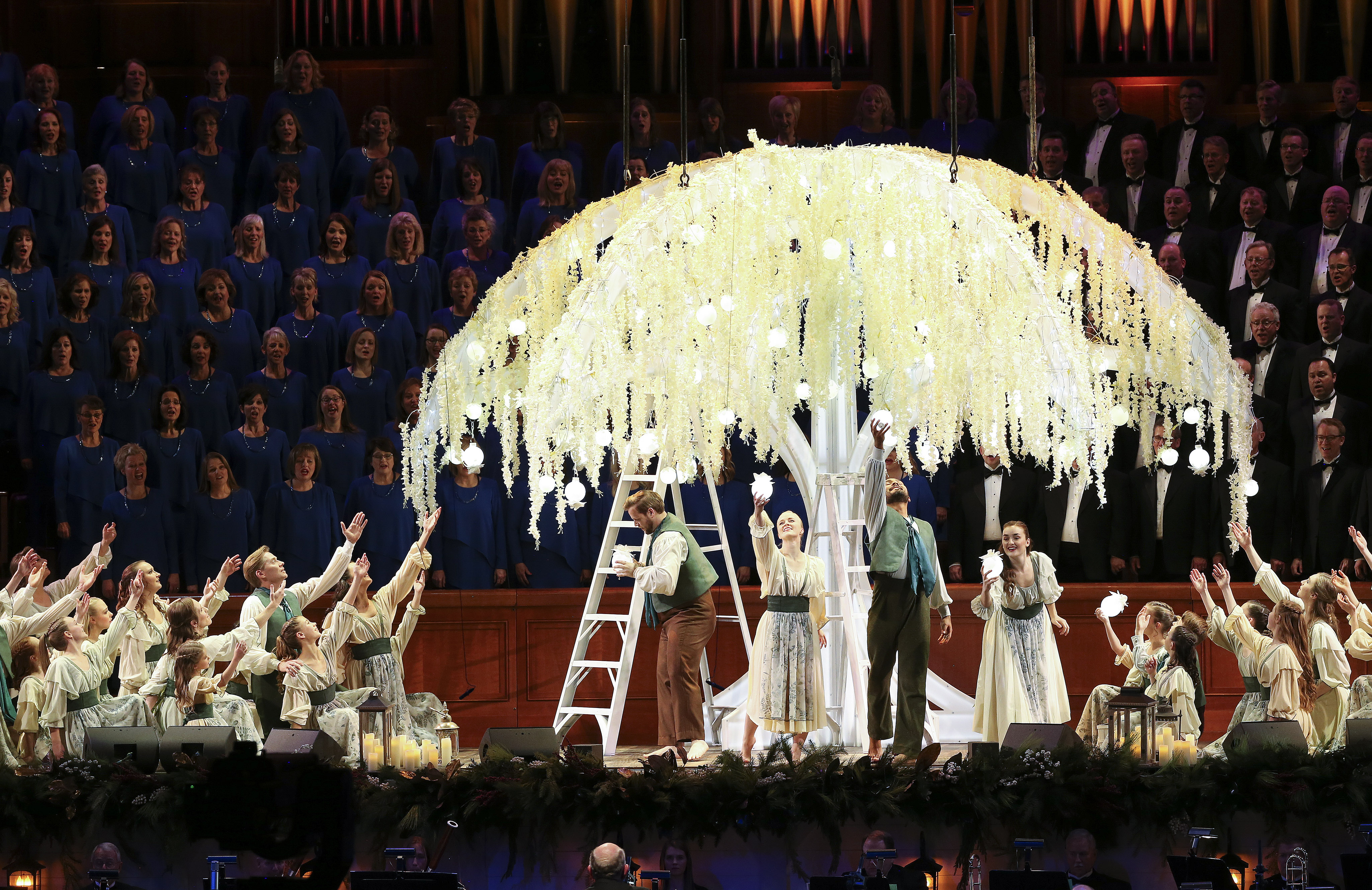 Dancers perform around the Tree of Life with the Tabernacle Choir at Temple Square and Orchestra at Temple Square during a Christmas concert at the Conference Center in Salt Lake City on Thursday, Dec. 12, 2019.
