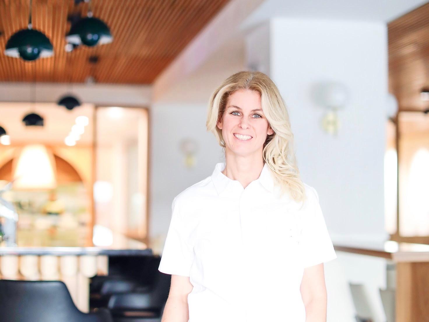 women in white shirt standing in restaurants