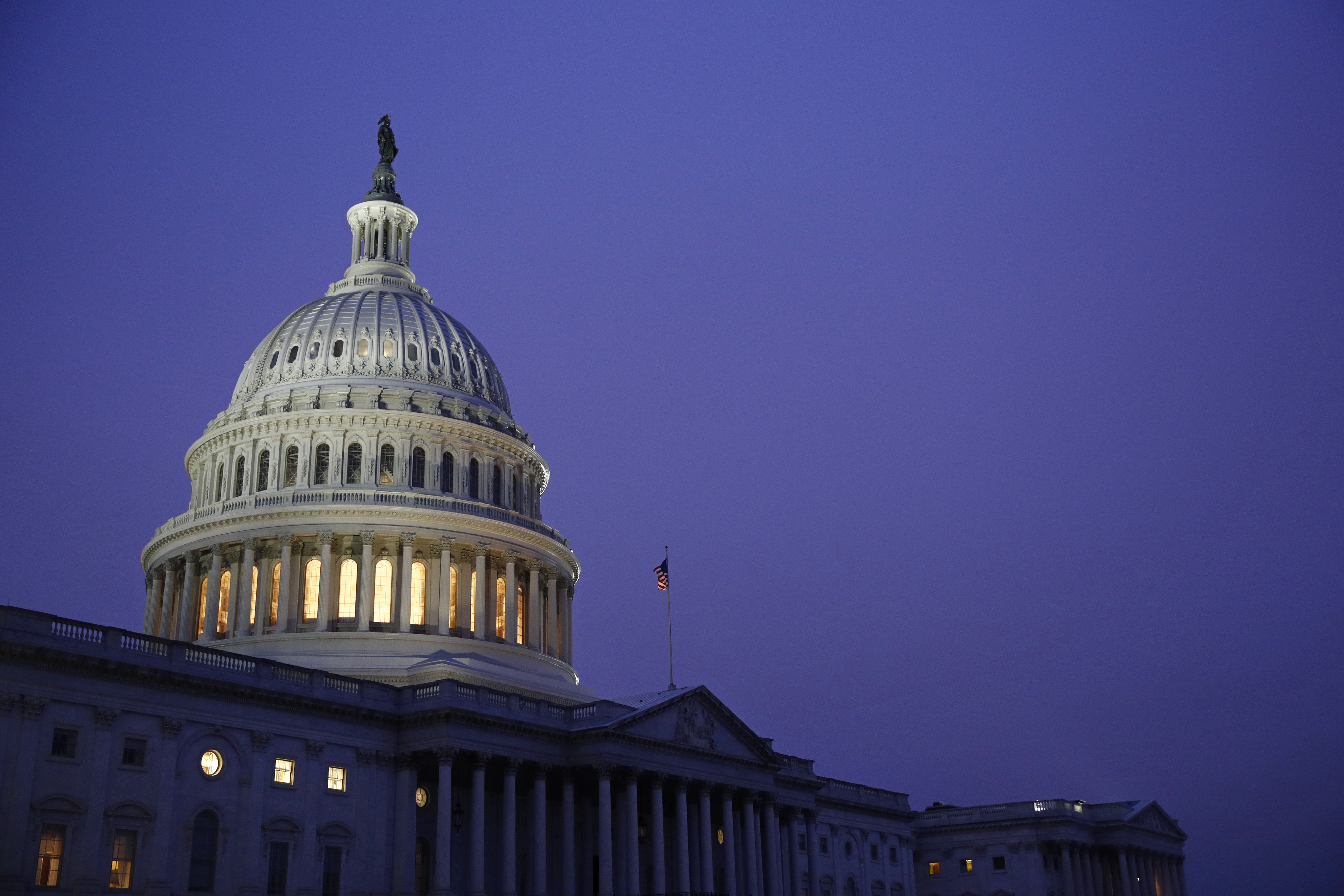 Light shines on the U.S. Capitol dome before a House Judiciary Committee markup of the articles of impeachment against President Donald Trump, Friday, Dec. 13, 2019, on Capitol Hill in Washington. Trump impeachment goes to full House after Judiciary panel approves charges of abuse of power, obstruction of Congress. (AP Photo/Patrick Semansky)