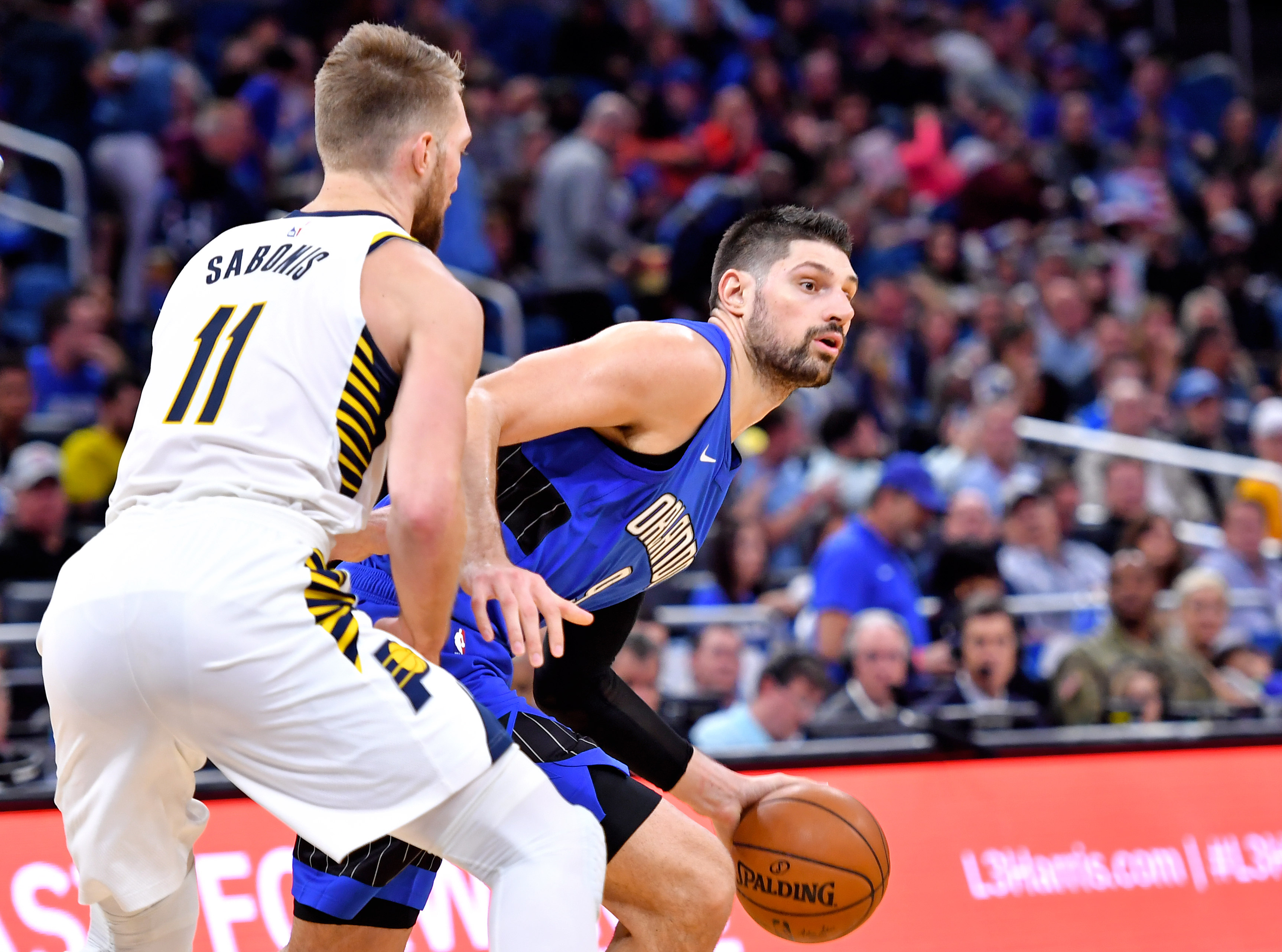 Orlando Magic center Nikola Vucevic is guarded by Indiana Pacers forward Domantas Sabonis during the second half at Amway Center.
