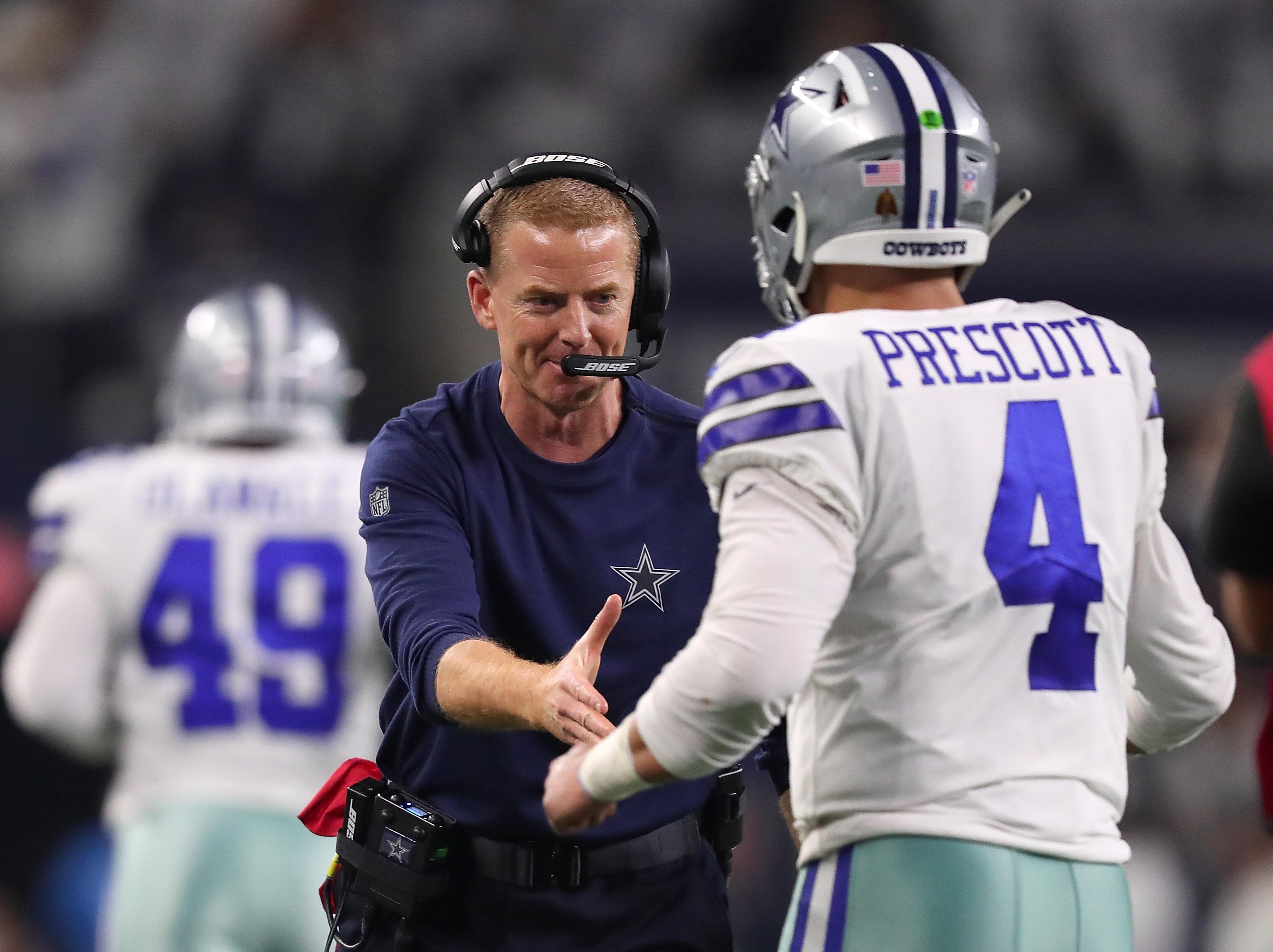 Dallas Cowboys HC Jason Garrett congratulates QB Dak Prescott during the Wild Card playoff game against the Seattle Seahawks, Jan. 5, 2019.