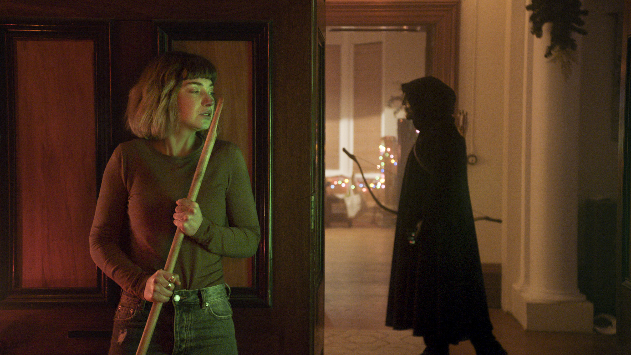 Riley (Imogen Poots) attempts to evade a masked invader.