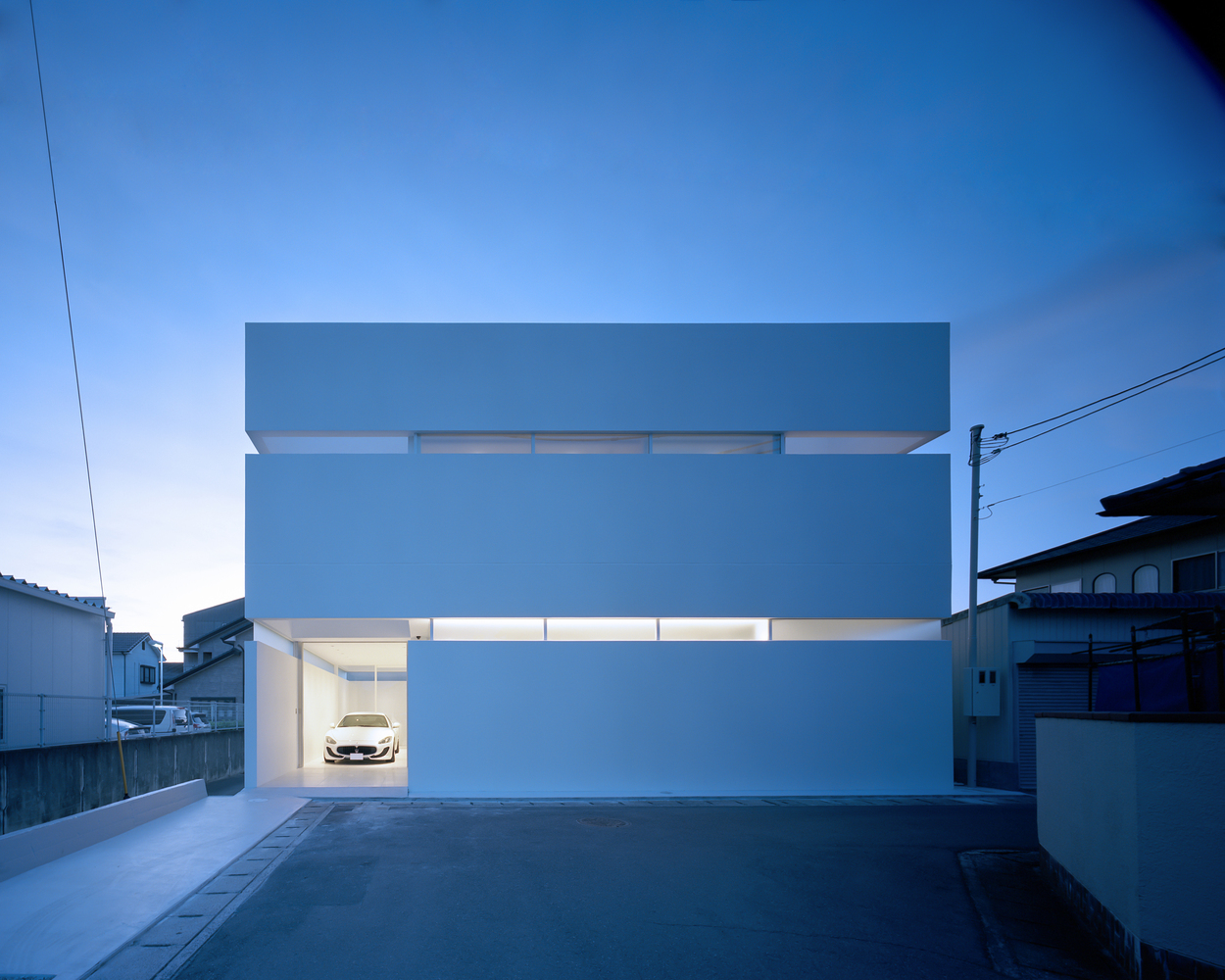 Modern house in Japan is all about privacy—and a car