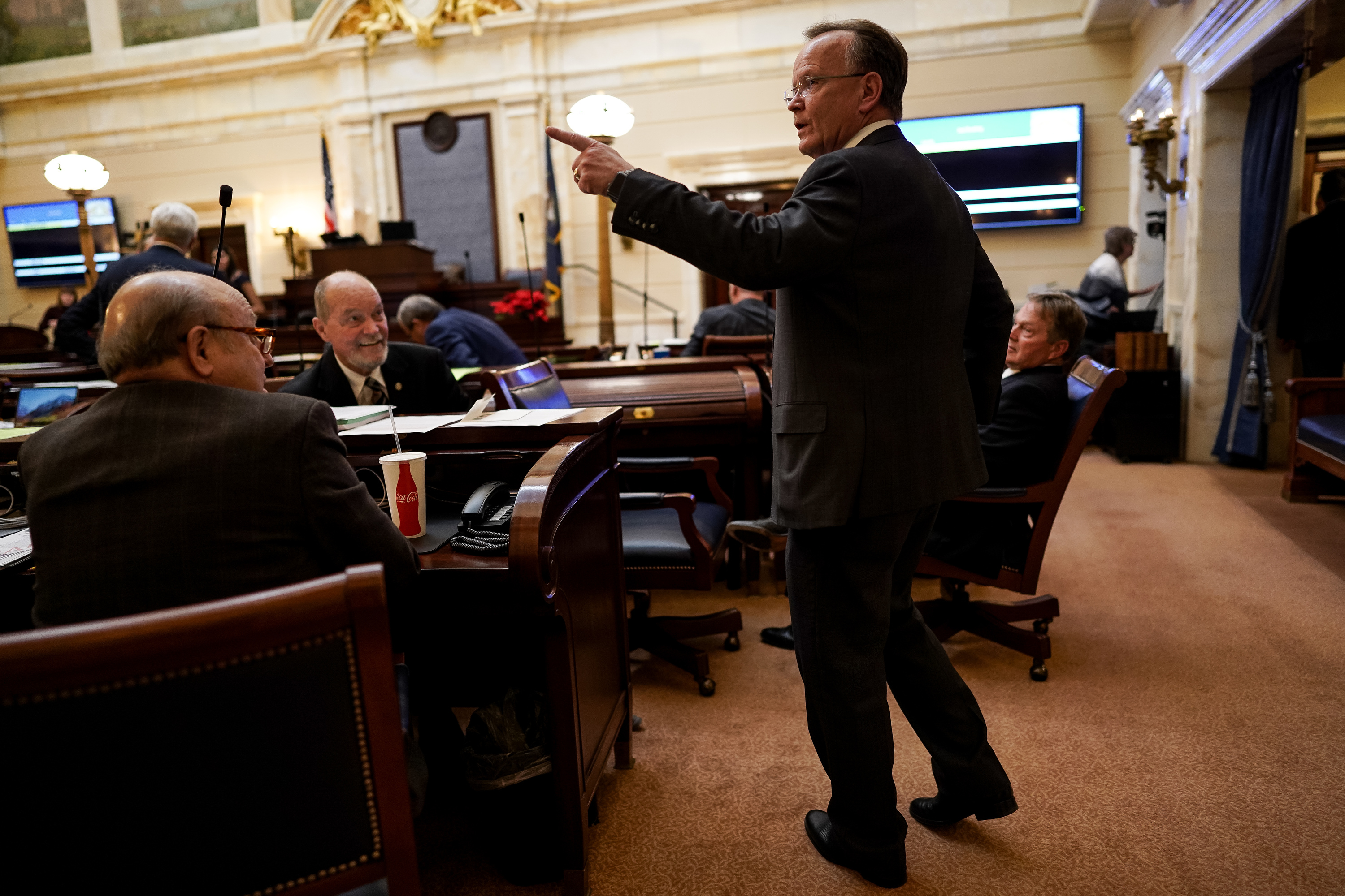 Senate President Stuart Adams, R-Layton, talks to others on the Senate floor after passing a tax reform bill during a special legislative session at the Capitol in Salt Lake City on Thursday, Dec. 12, 2019.
