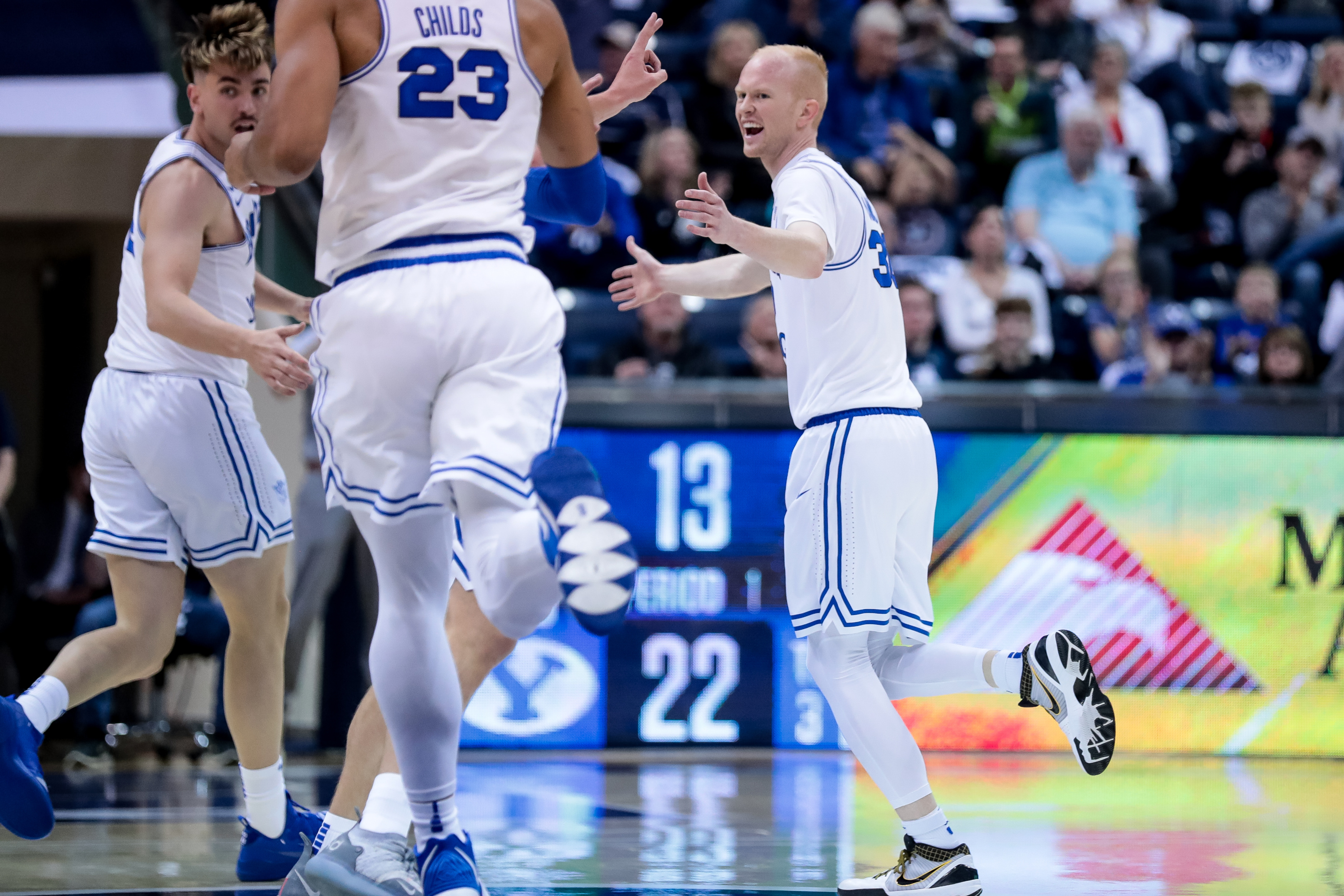 Brigham Young Cougars guard TJ Haws (30) celebrates after sinking a three during the game against the Nevada Wolf Pack at the Marriott Center in Provo on Tuesday, Dec. 10, 2019.
