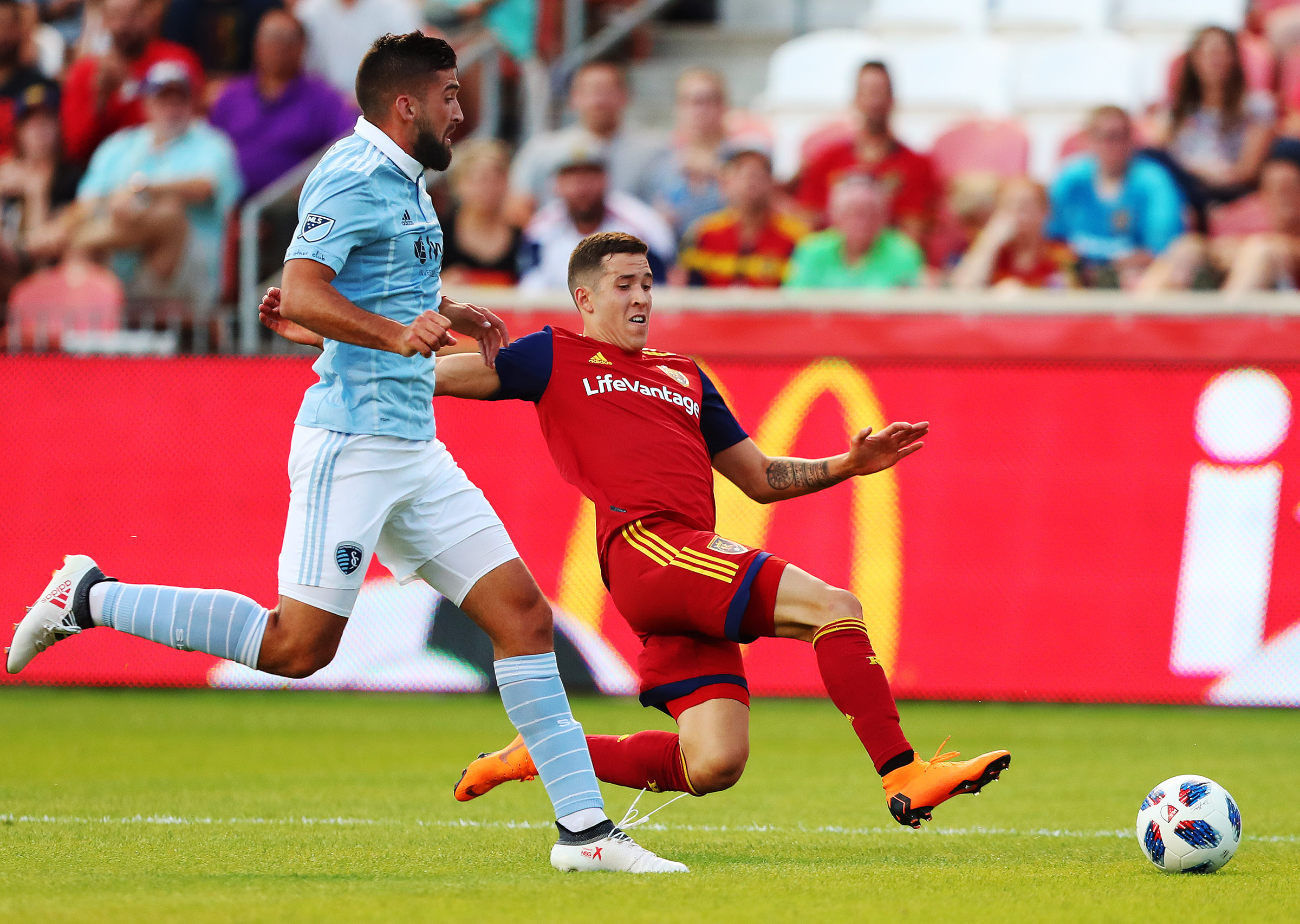 Sporting KC's Emiliano Amor and Real Salt Lake's Aaron Herrera chase down the ball as they play in Open Cup fourth-round action at Rio Tinto Stadium in Sandy on Wednesday, June 6, 2018.