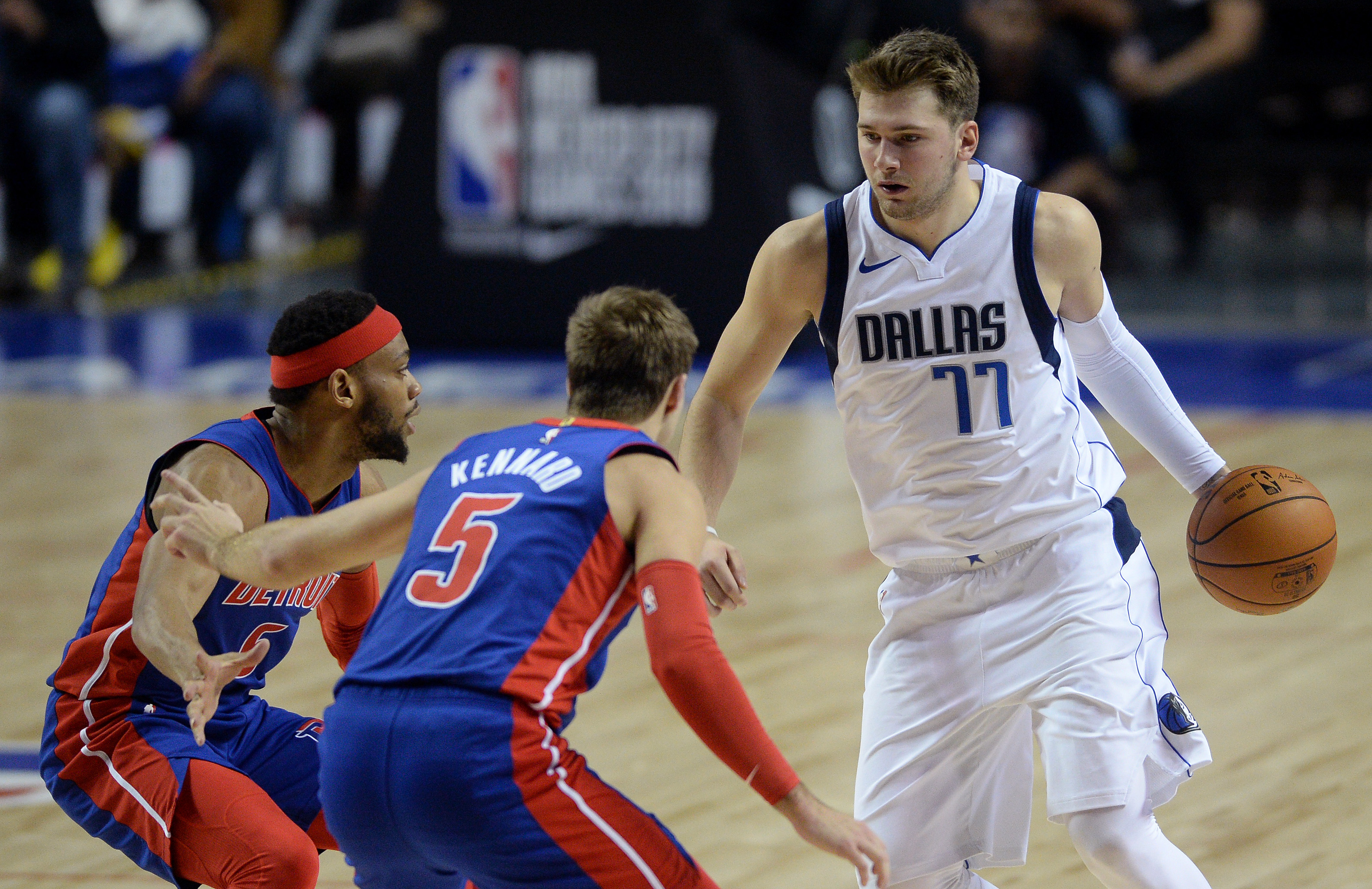 Dallas Mavericks forward Luka Doncic dribbles the ball while defended by Detroit Pistons guards Luke Kennard and Bruce Brown during the second half at Mexico City Arena.