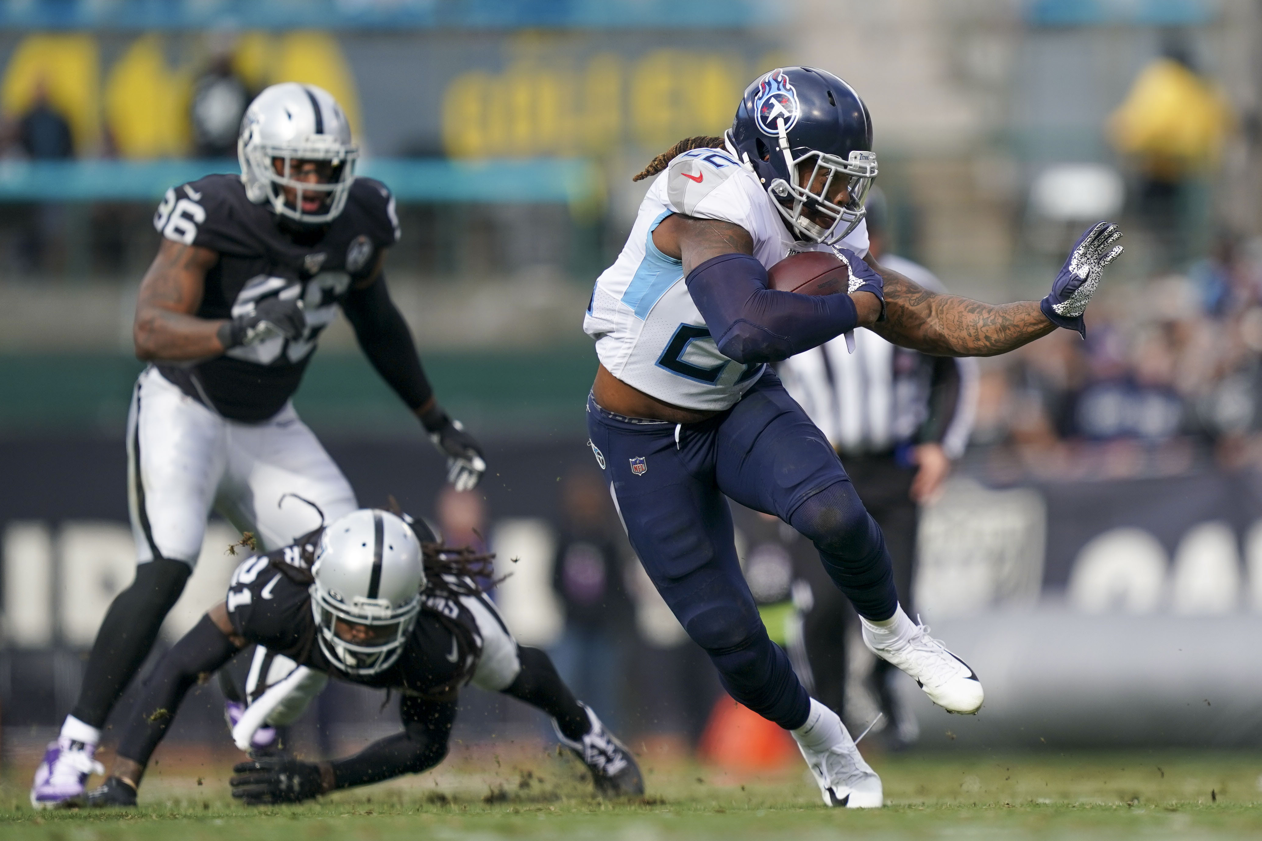 Tennessee Titans running back Derrick Henry runs the football against Oakland Raiders free safety D.J. Swearinger during the first quarter at Oakland Coliseum.