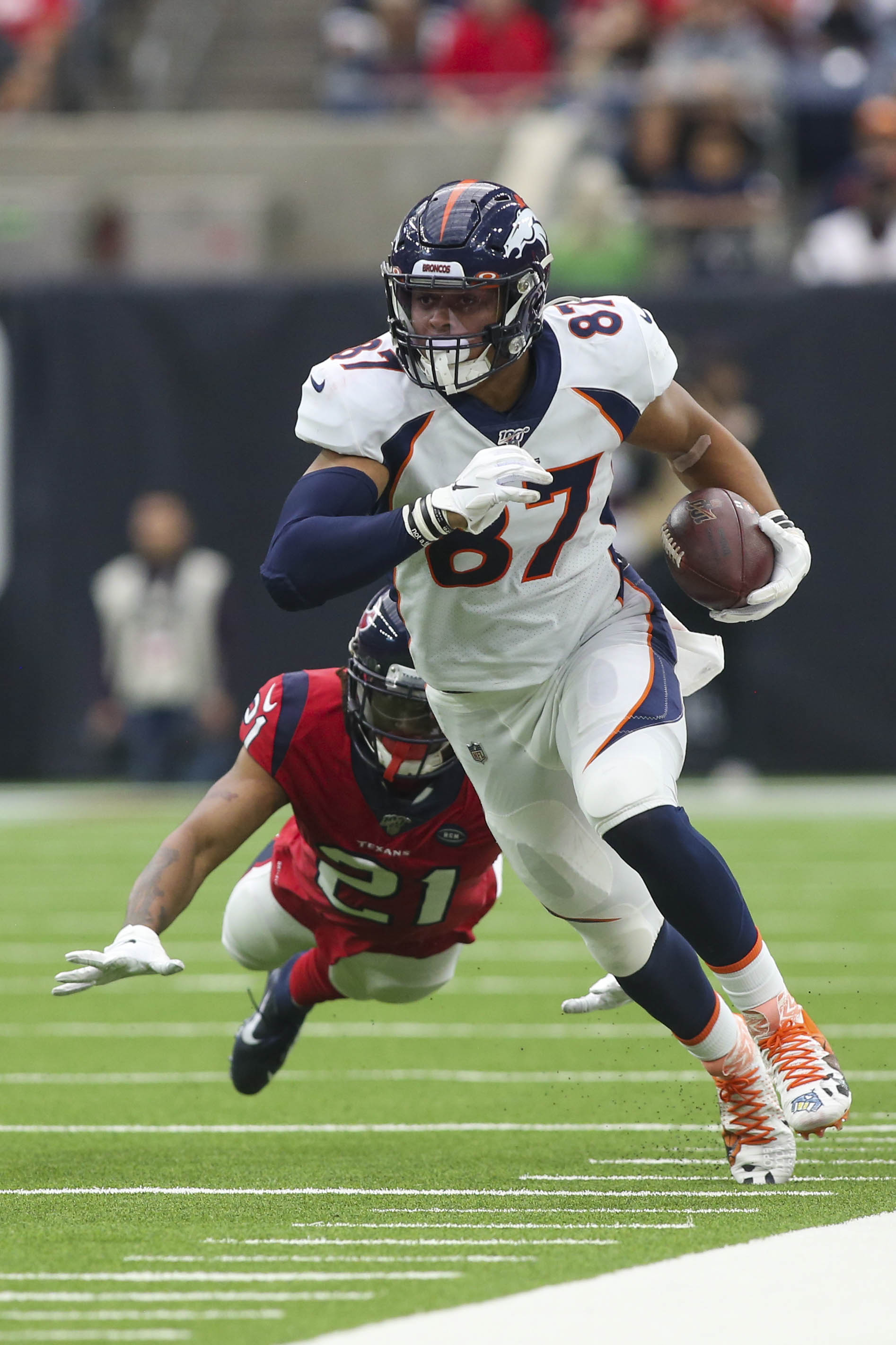 Denver Broncos tight end Noah Fant runs after a reception while Houston Texans cornerback Bradley Roby fails to make the tackle at NRG Stadium.