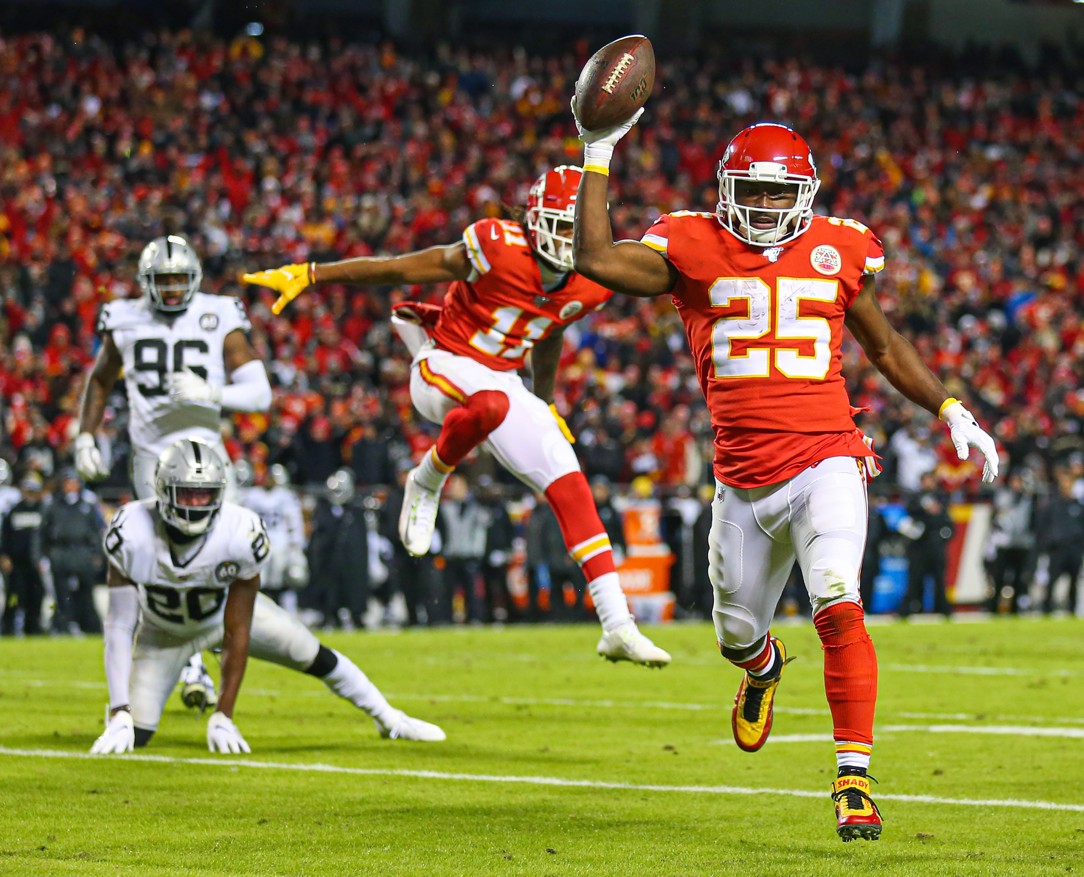 Kansas City Chiefs running back LeSean McCoy celebrates as he runs for a touchdown against the Oakland Raiders during the second half at Arrowhead Stadium.
