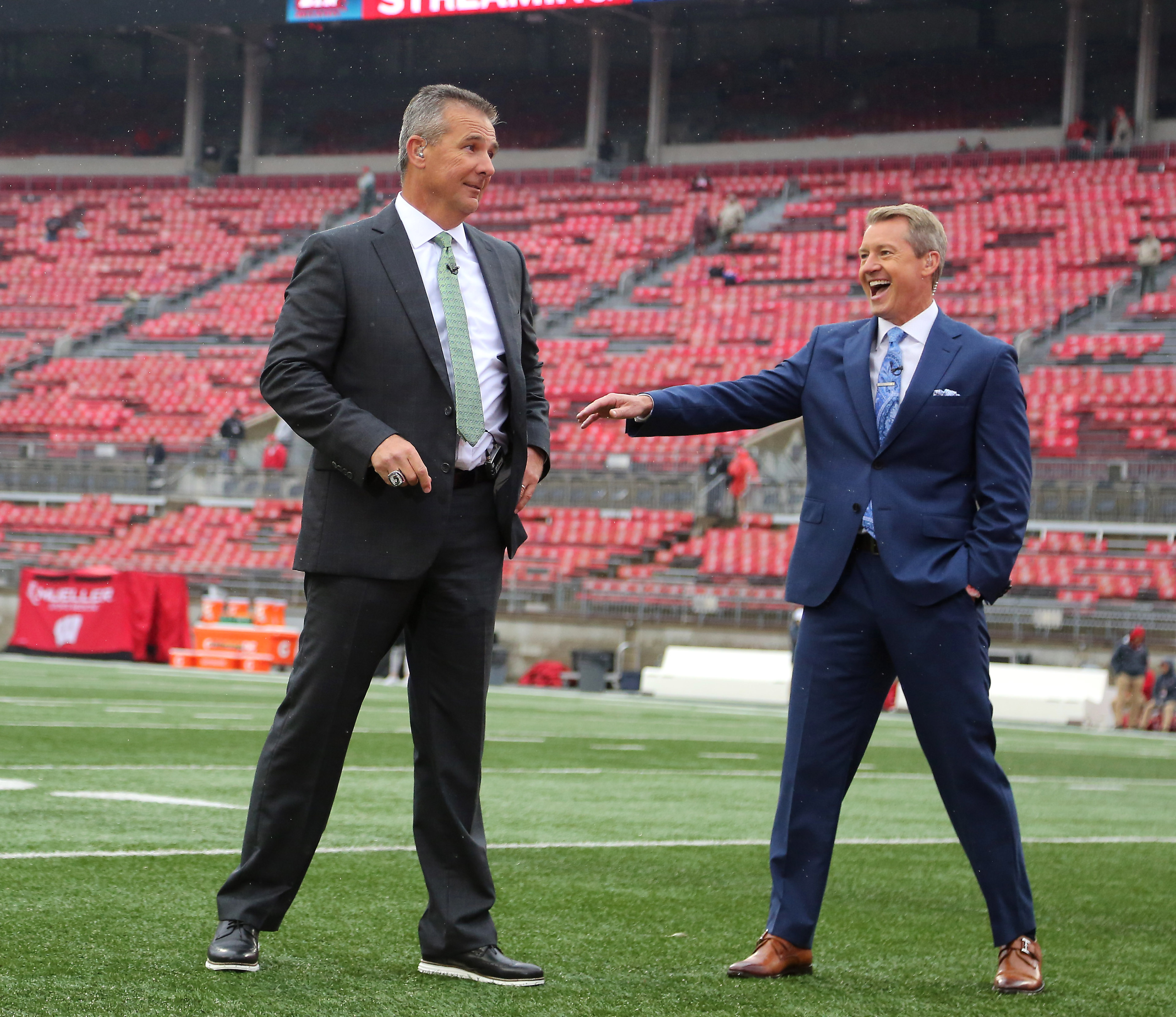 Ohio State Buckeyes former head coach Urban Meyer with Fox broadcaster Rob Stone before the game between the Ohio State Buckeyes and the Wisconsin Badgers at Ohio Stadium.