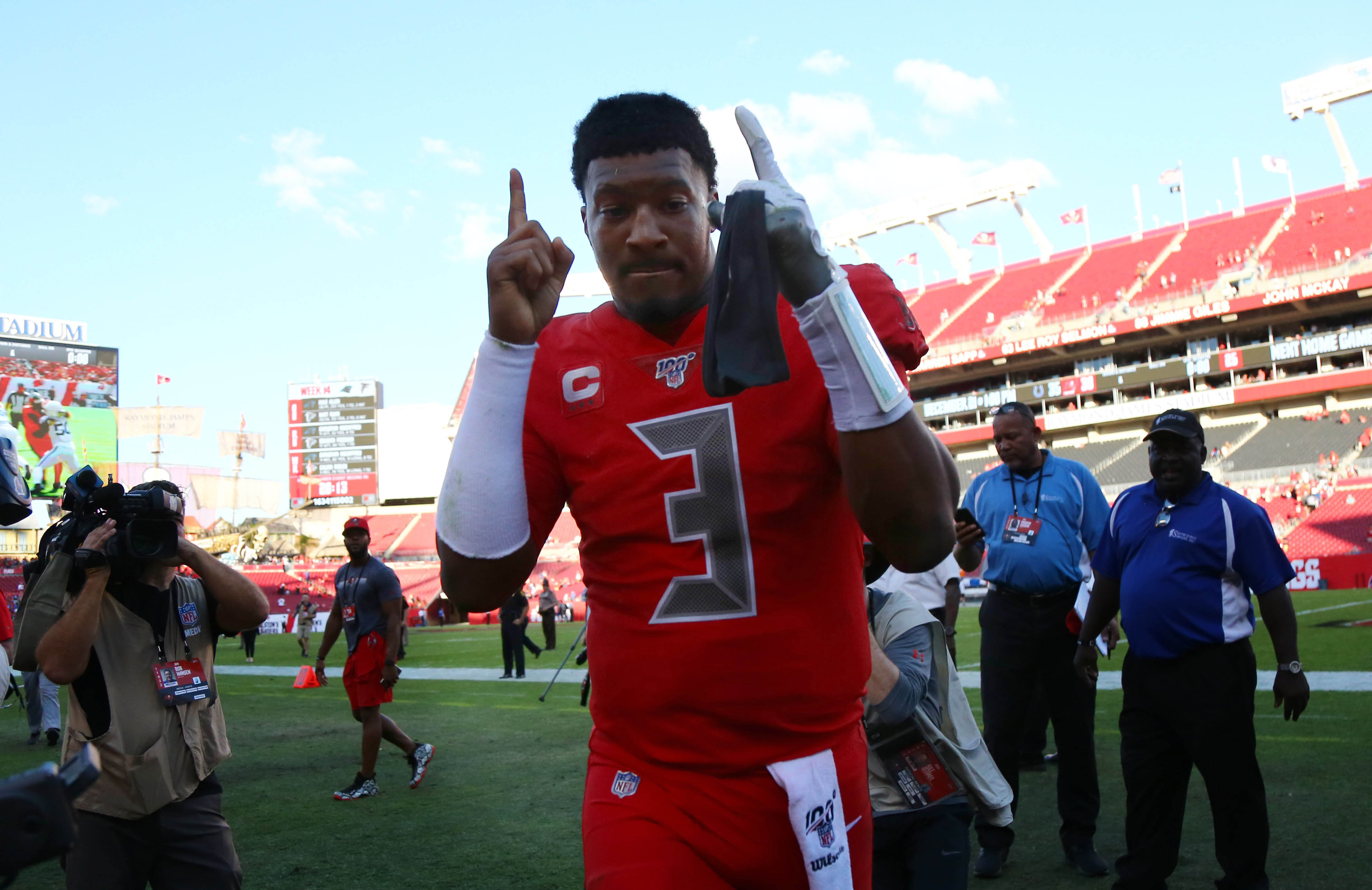 Tampa Bay Buccaneers quarterback Jameis Winston celebrates as he runs off the field after they beat the Indianapolis Colts at Raymond James Stadium.