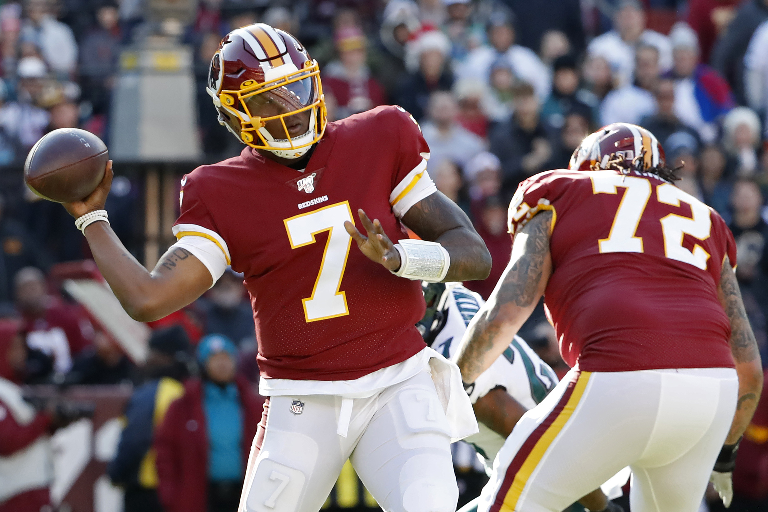 Washington Redskins quarterback Dwayne Haskins passes the ball as Philadelphia Eagles strong safety Malcolm Jenkins chases in the first quarter at FedExField