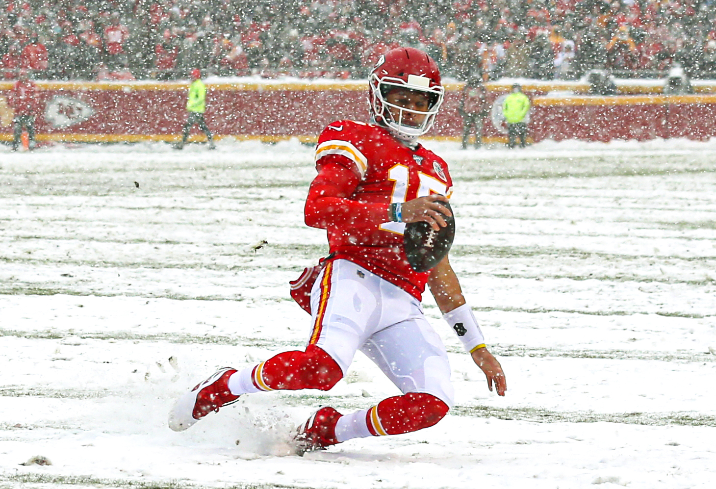 Kansas City Chiefs quarterback Patrick Mahomes slides against the Denver Broncos during the first half at Arrowhead Stadium.
