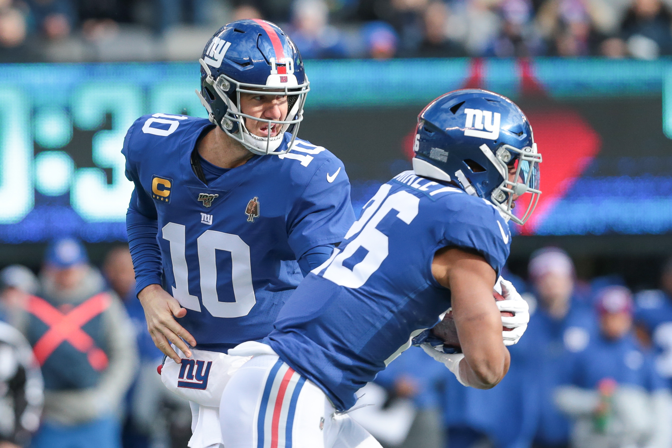 New York Giants quarterback Eli Manning hands off to running back Saquon Barkley during the first quarter against the Miami Dolphins at MetLife Stadium.