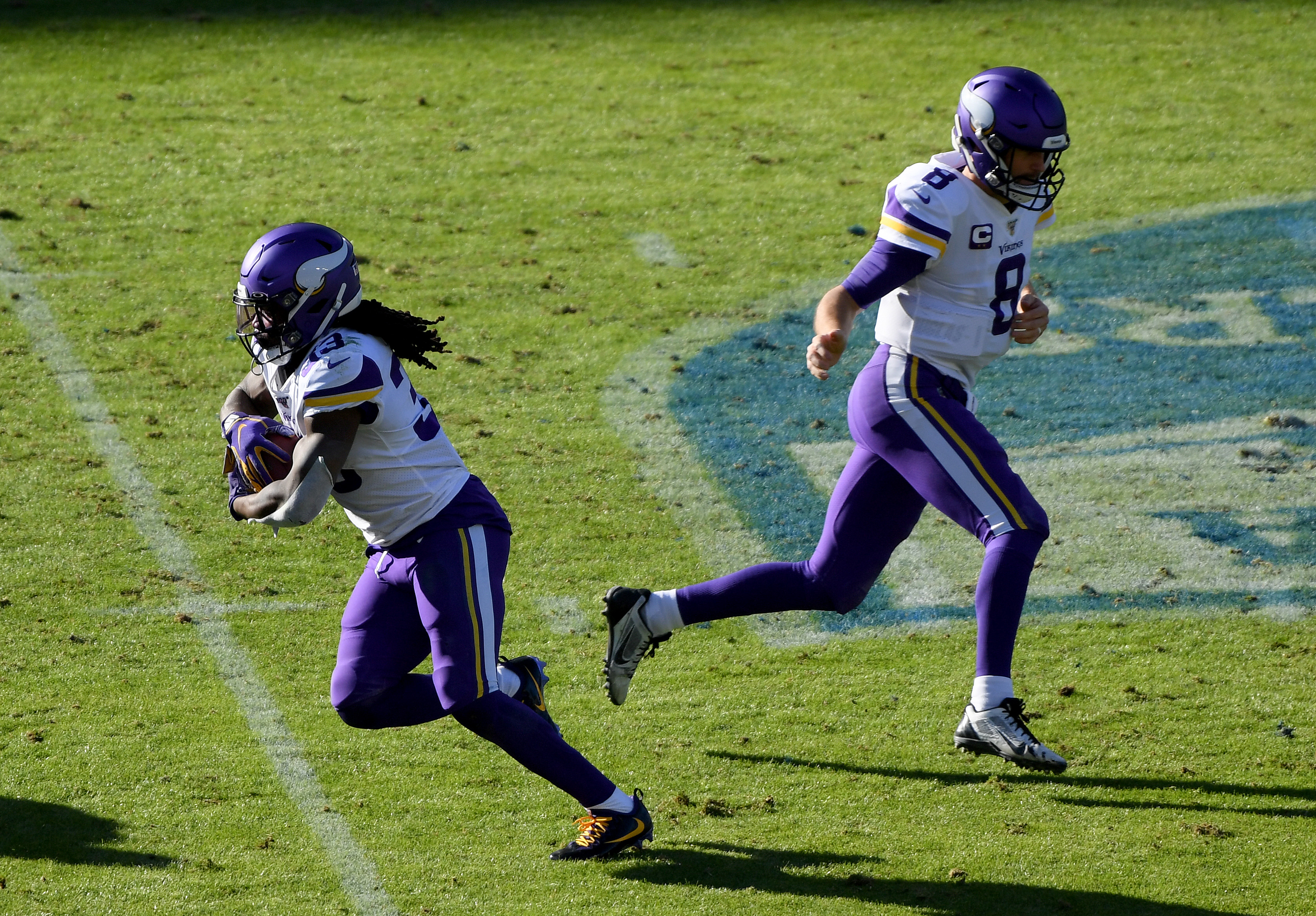 Dalvin Cook of the Minnesota Vikings takes a handoff from Kirk Cousins during the second quarter against the Los Angeles Chargers at Dignity Health Sports Park on December 15, 2019 in Carson, California.