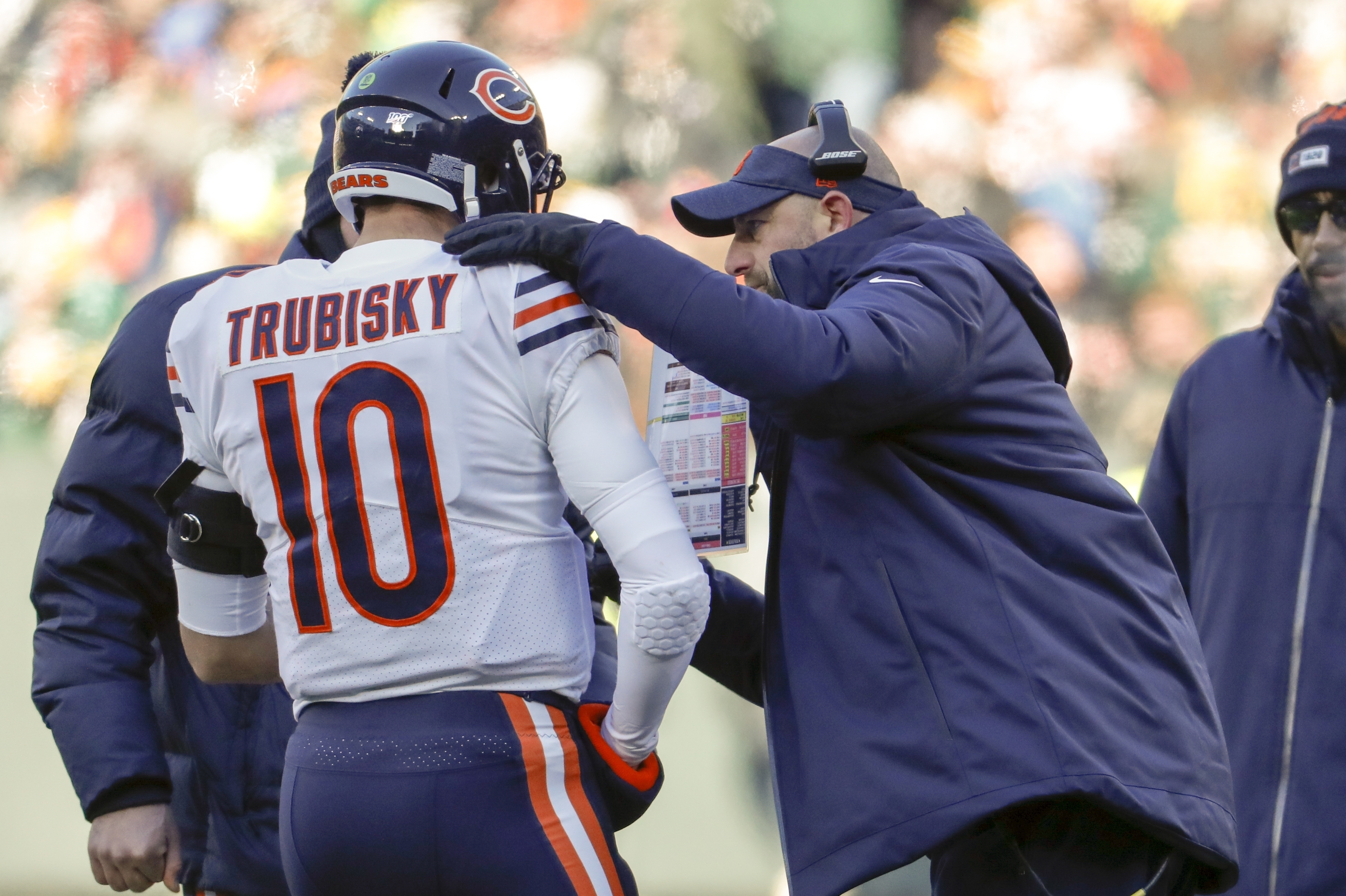 Bears coach Matt Nagy talks to QB Mitch Trubisky during the first half of Sunday's loss to the Packers in Green Bay.