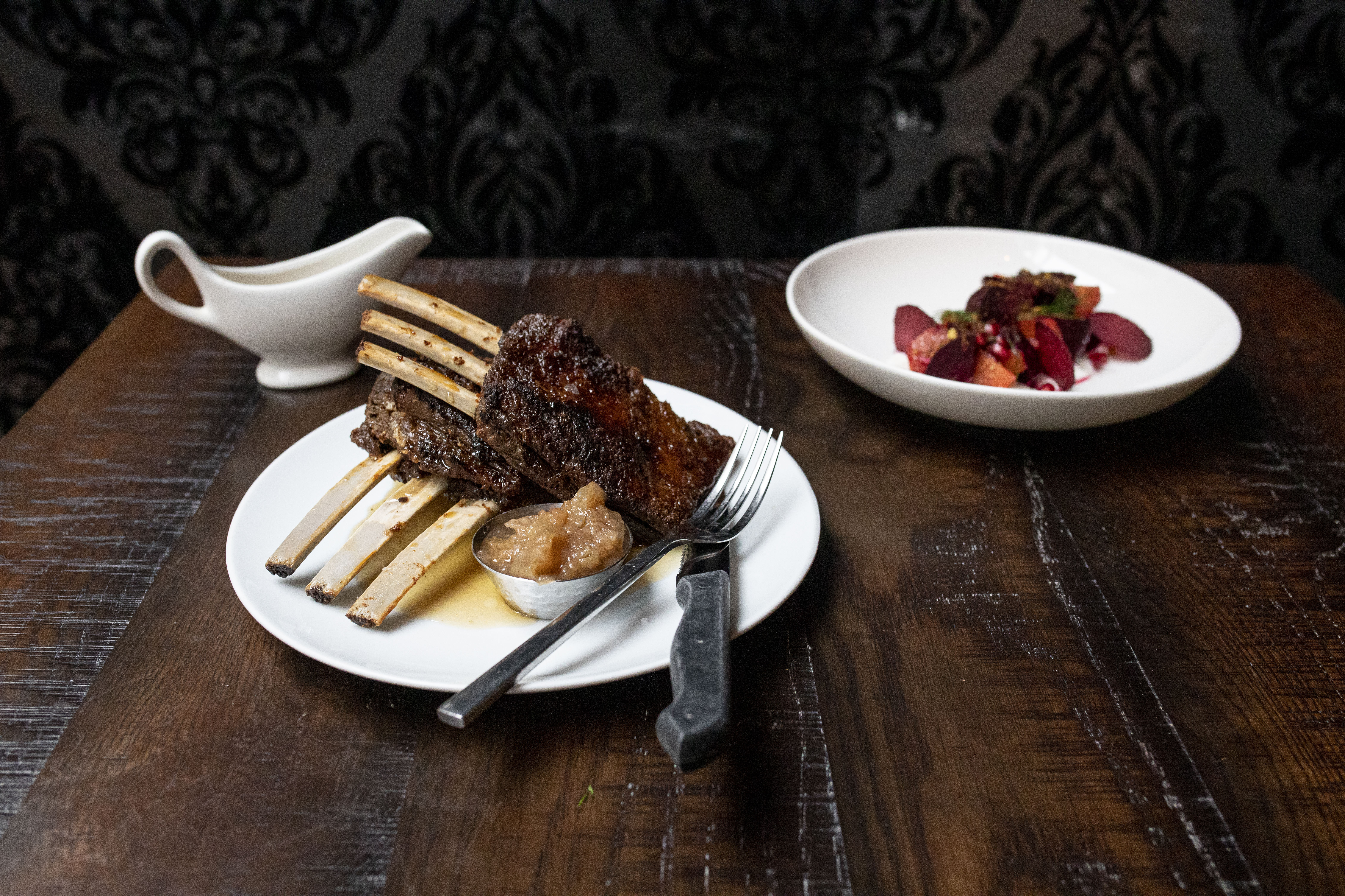 A plate of maple-glazed boar ribs from the Partisan