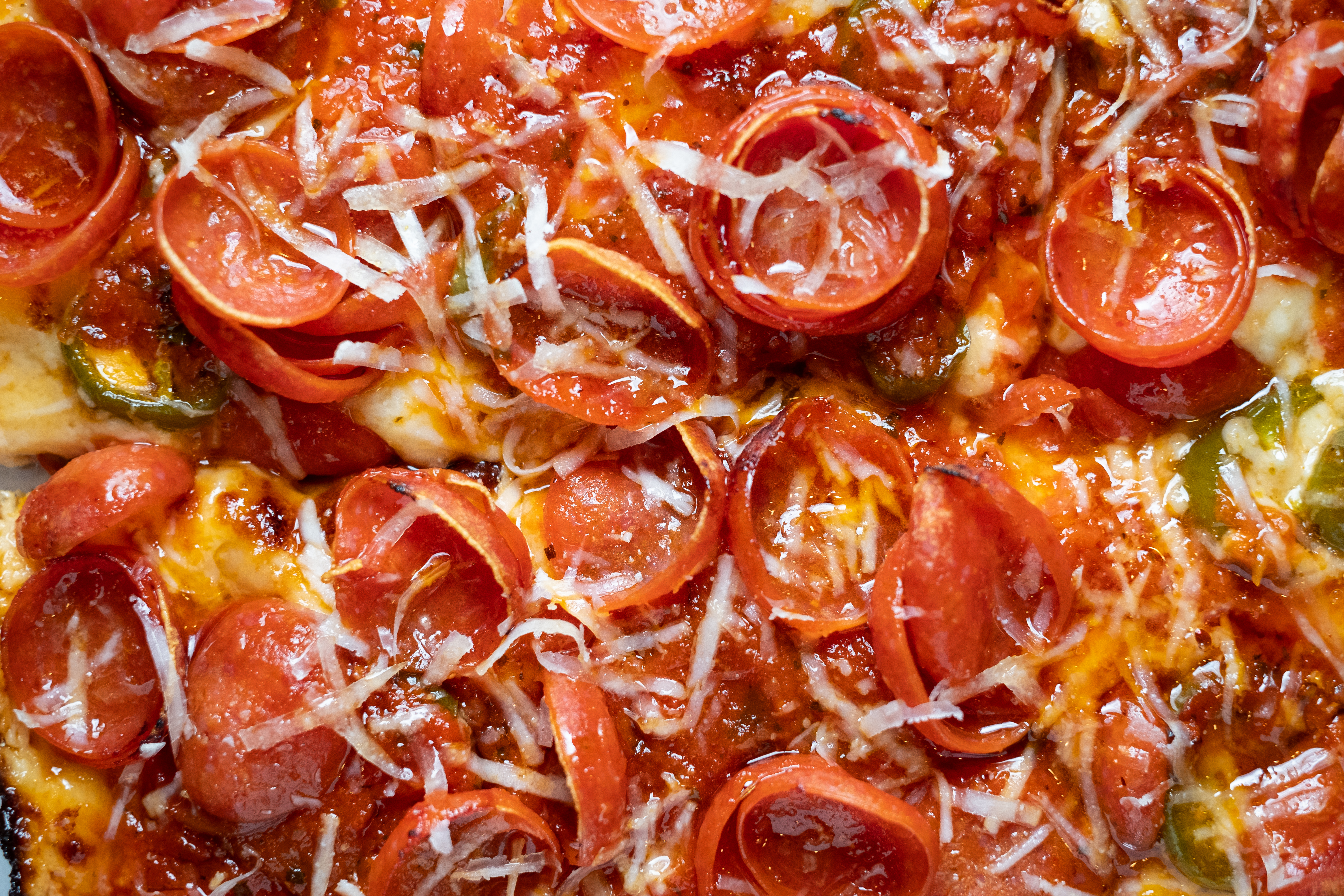 Extreme close-up of curly pepperoni pizza from Wrecktangle.