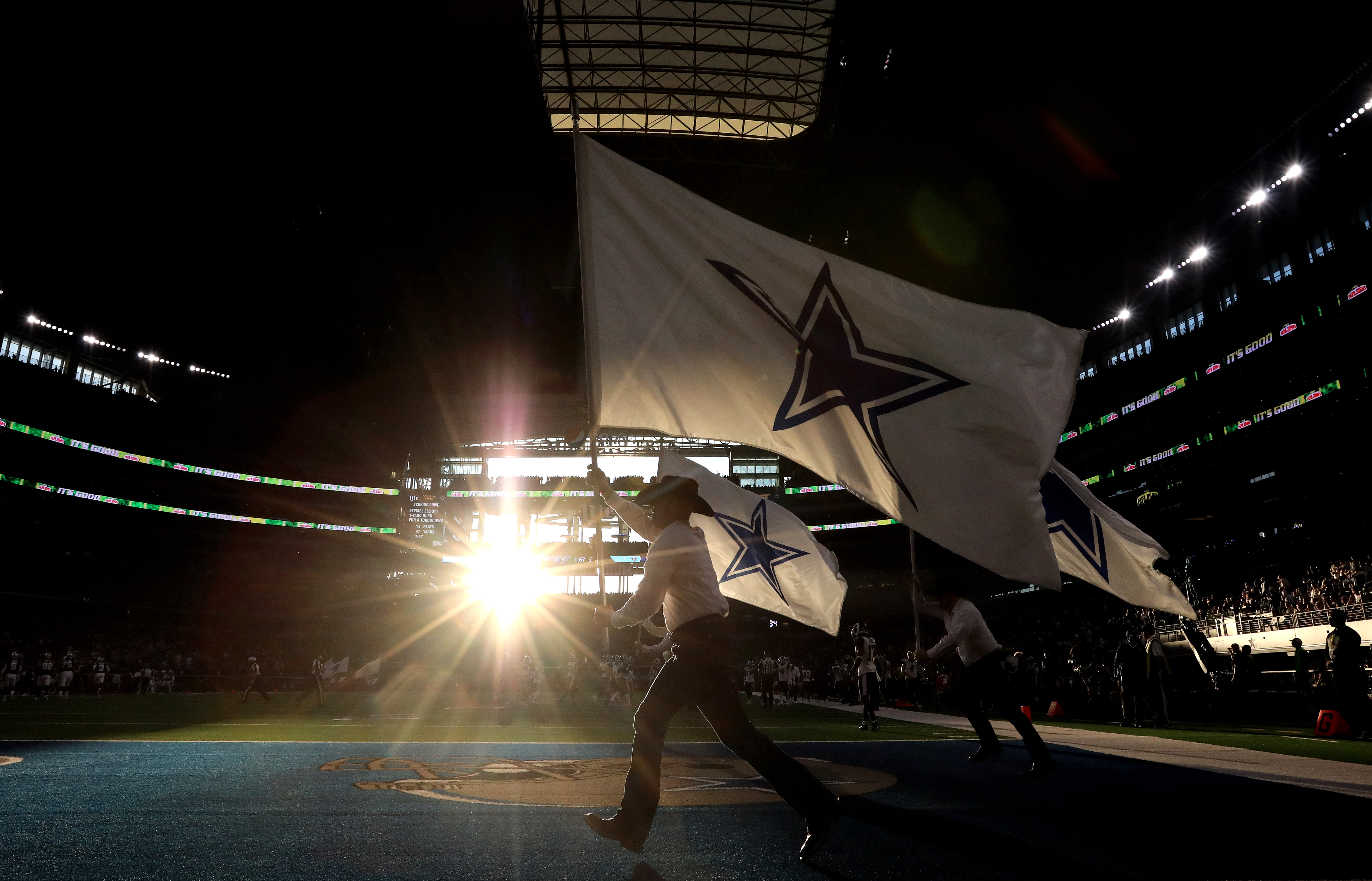 The Dallas Cowboys flag team runs on the field after a Cowboys touchdown against the Los Angeles Rams in Week 15, Dec. 15, 2019.