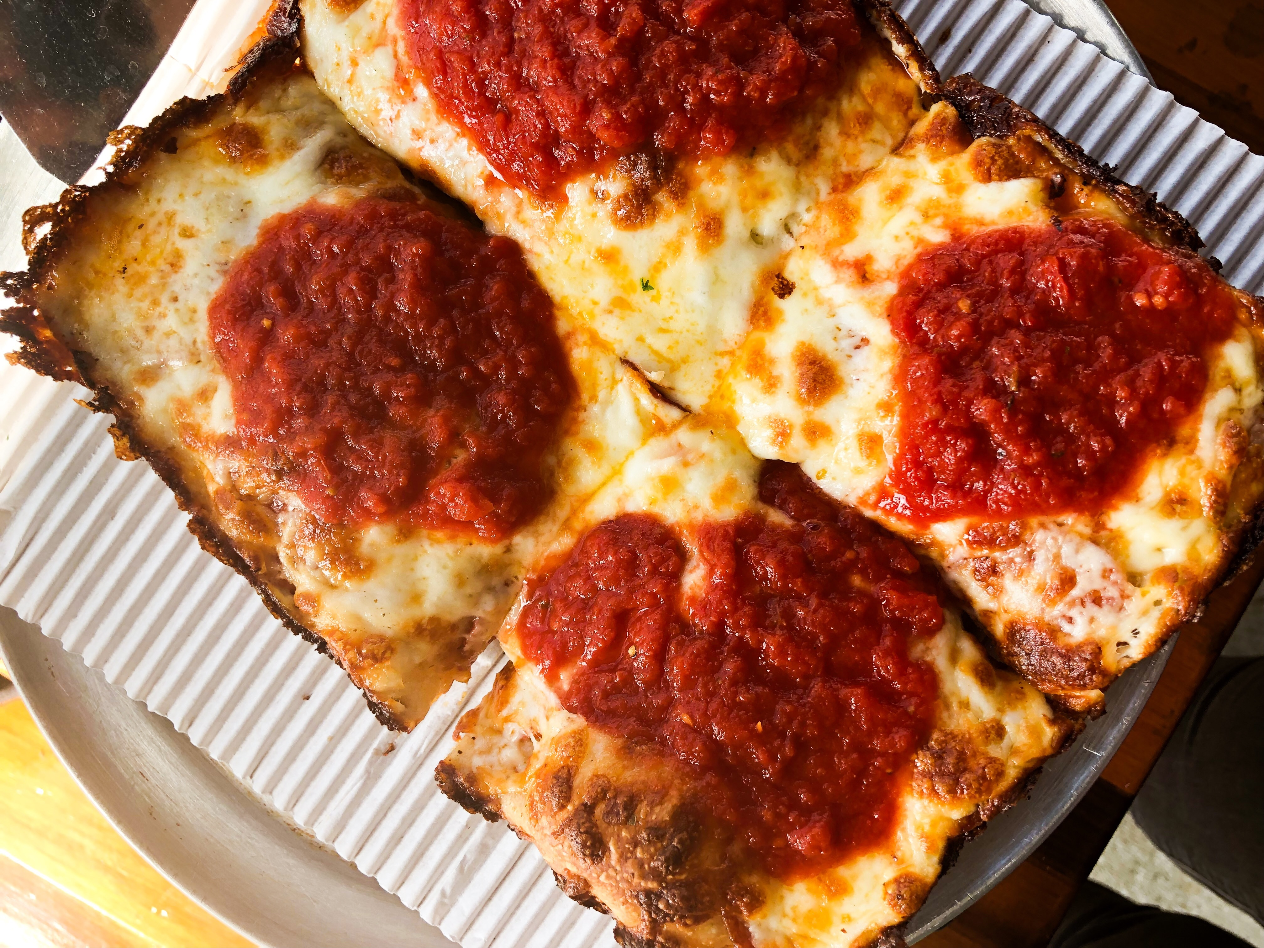 A Detroit-style pizza from Assembly Brewing, with dollops of brick-red tomato sauce