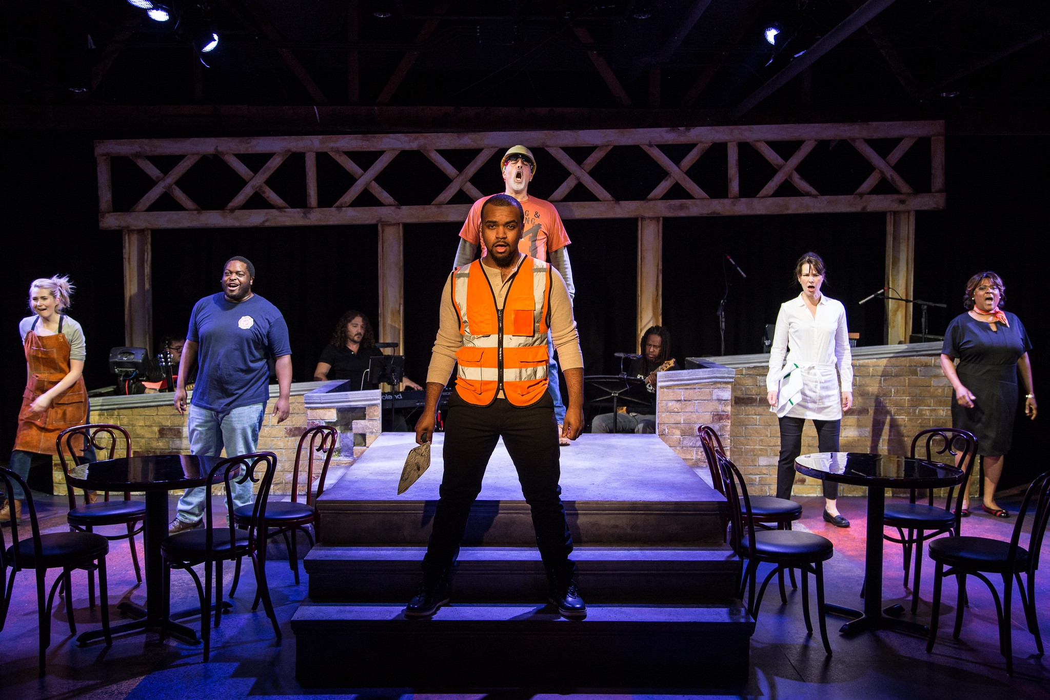 """The cast of Theo-Ubique's production of """"Working"""" includes: Kiersten Frumkin (from left), Jared David Michael Grant, Stephen Blu Allen, Michael Kingston, Loretta Rezos, Cynthia F. Carter. and (background, in band) Perry Cowdery, Jeremy Ramey and Rafe Bradford."""