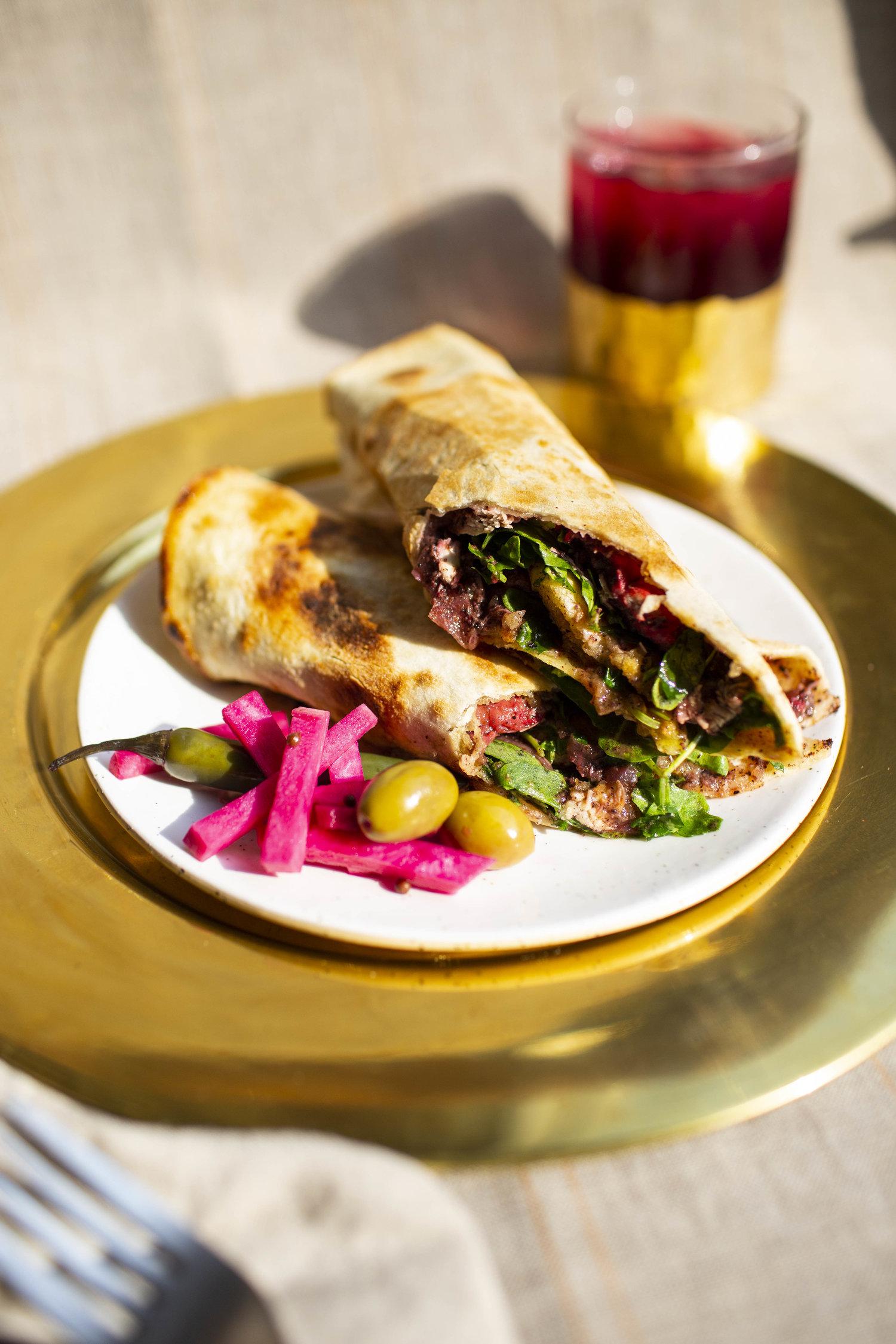 A flatbread sandwich at Reem's